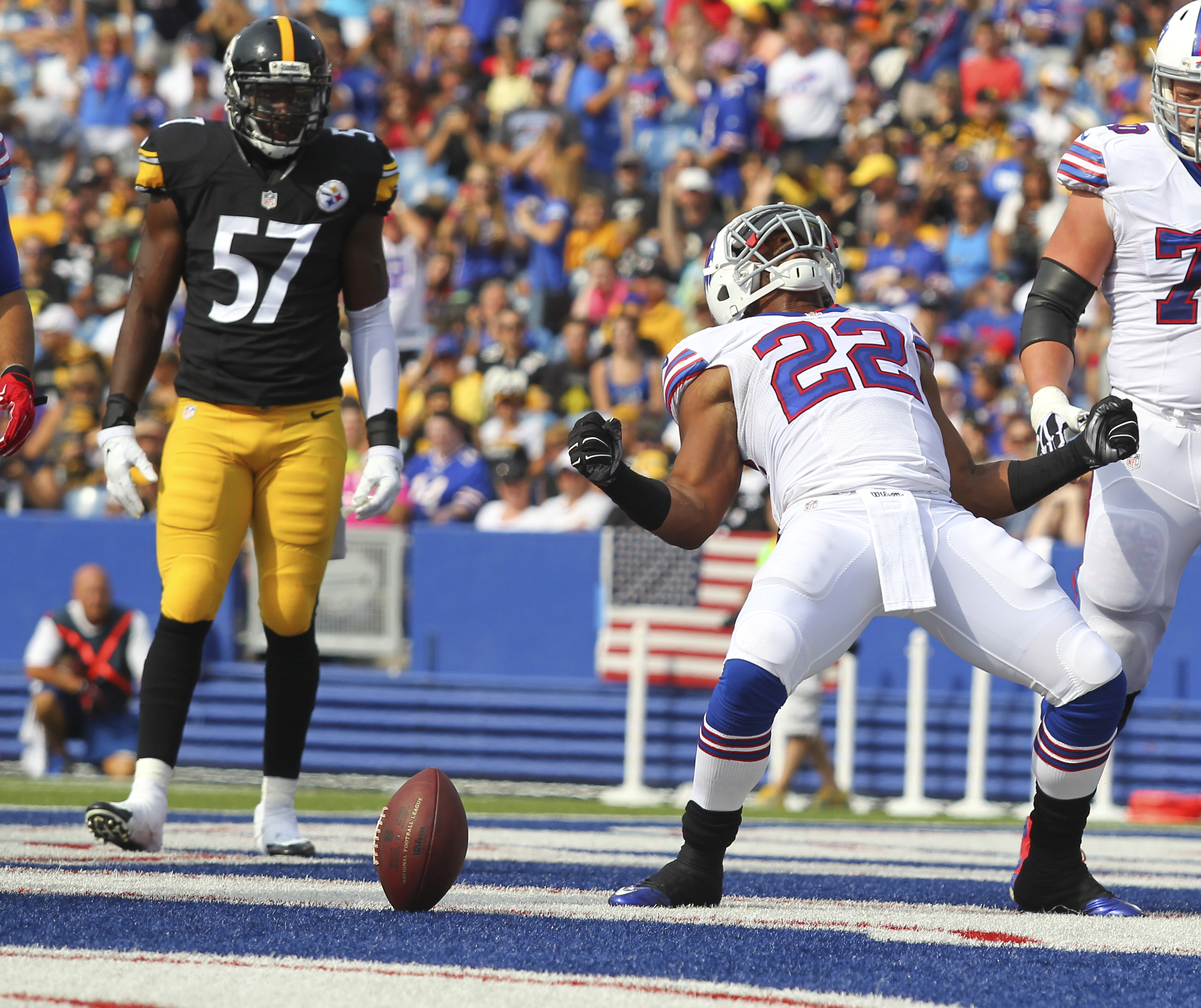 Buffalo Bills running back Fred Jackson (22) celebrates his touchdown in front of Pittsburgh Steelers inside linebacker Terence Garvin (57) during the first half of a preseason NFL football game on Saturday, Aug. 29, 2015, in Orchard Park, N.Y. (AP Photo/