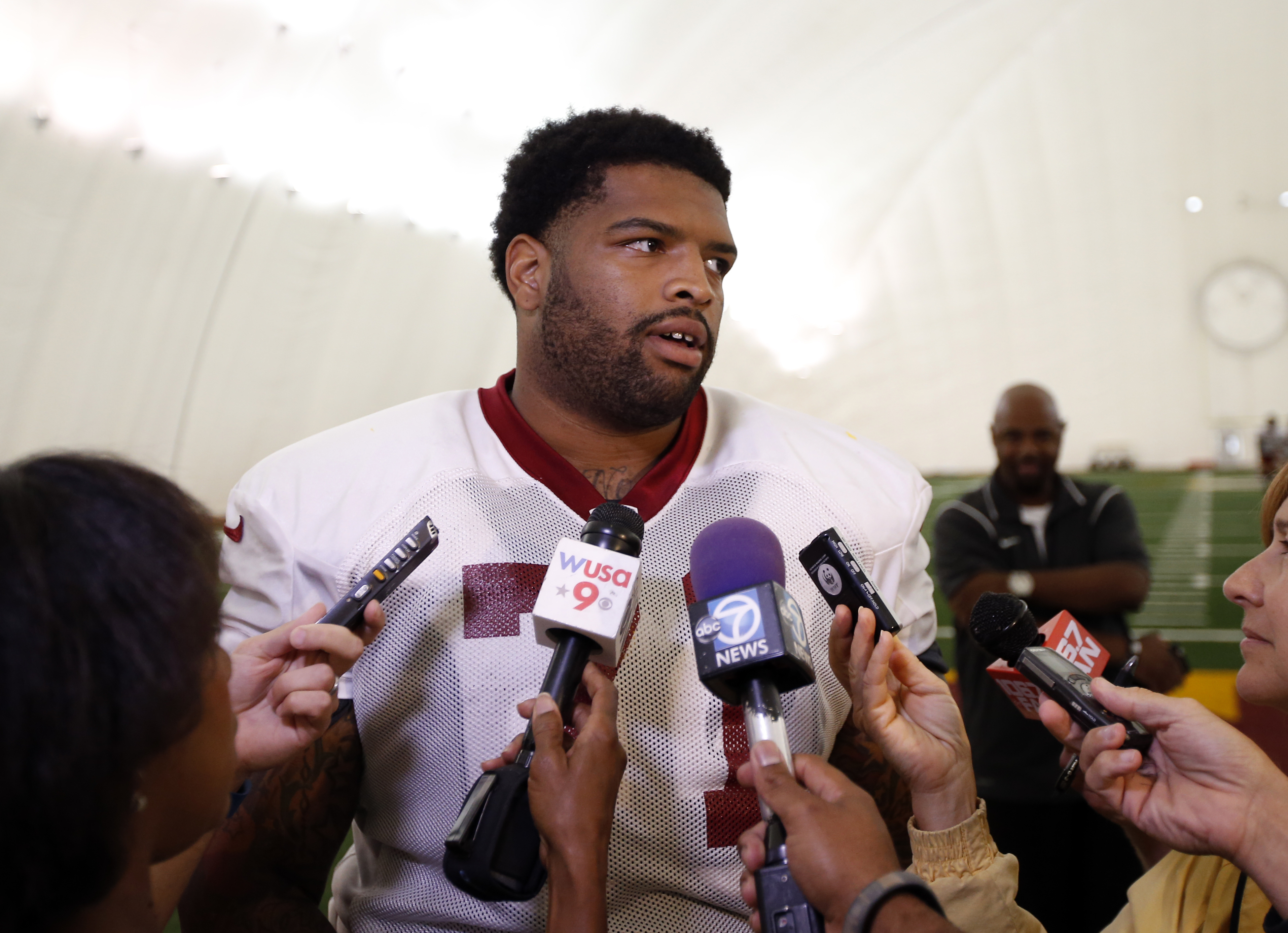 Washington Redskins tackle Trent Williams (71) speaks to reporters after NFL football practice, Tuesday, Aug. 18, 2015, in Ashburn, Va. (AP Photo/Alex Brandon)