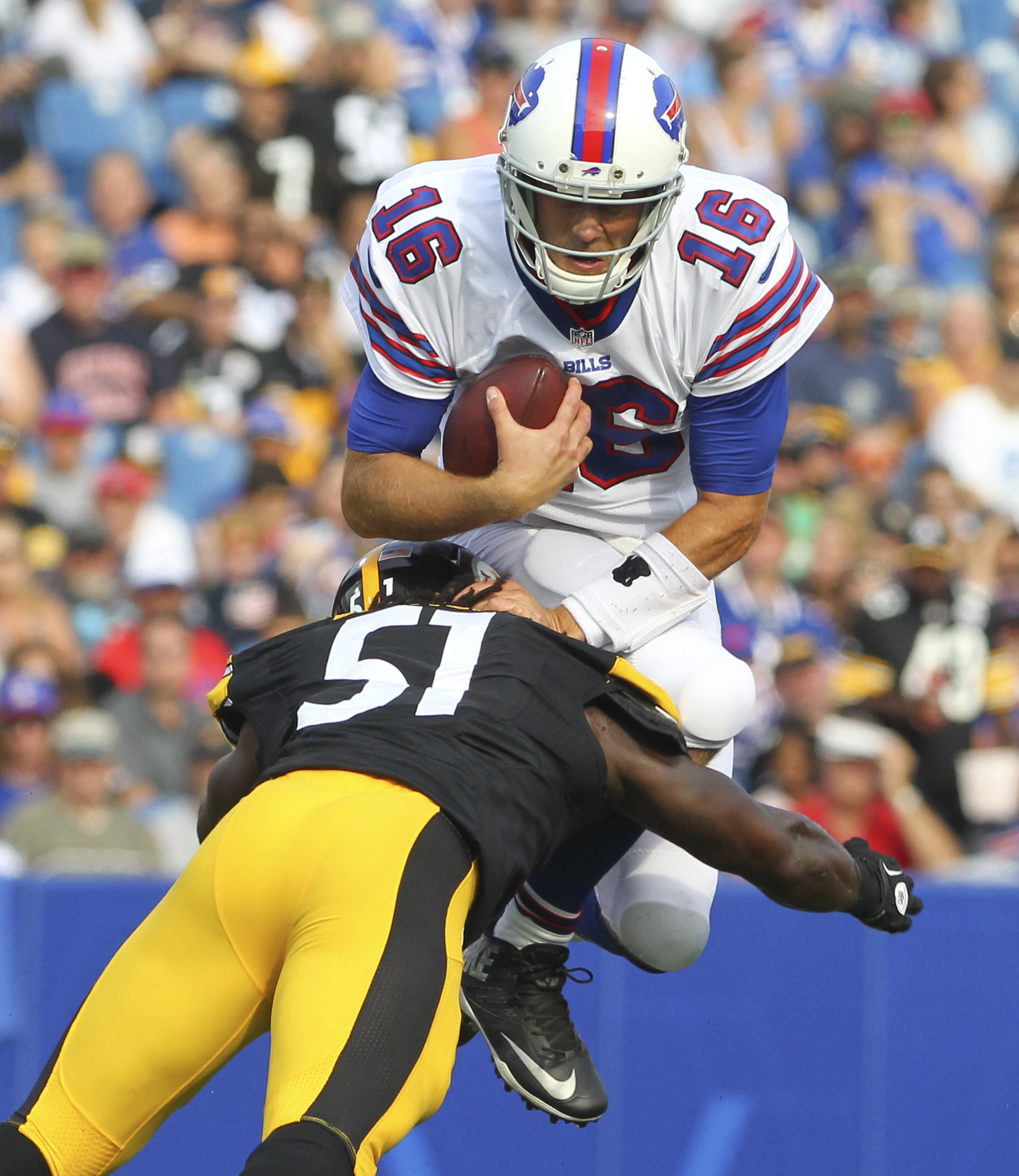 Buffalo Bills quarterback Matt Cassel (16) is stopped short of a first down as he is hit by Pittsburgh Steelers inside linebacker Sean Spence (51) during the first half of a preseason NFL football game on Saturday, Aug. 29, 2015, in Orchard Park, N.Y. (AP