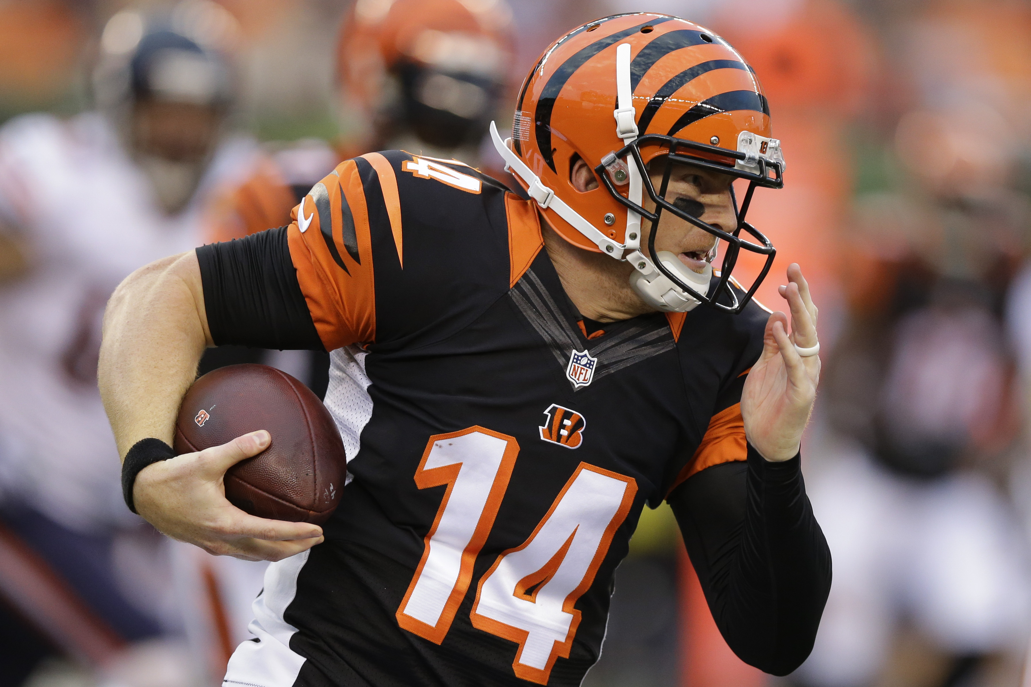 Cincinnati Bengals quarterback Andy Dalton runs the ball in the first half of an NFL preseason football game against the Chicago Bears, Saturday, Aug. 29, 2015, in Cincinnati. (AP Photo/072012001006)