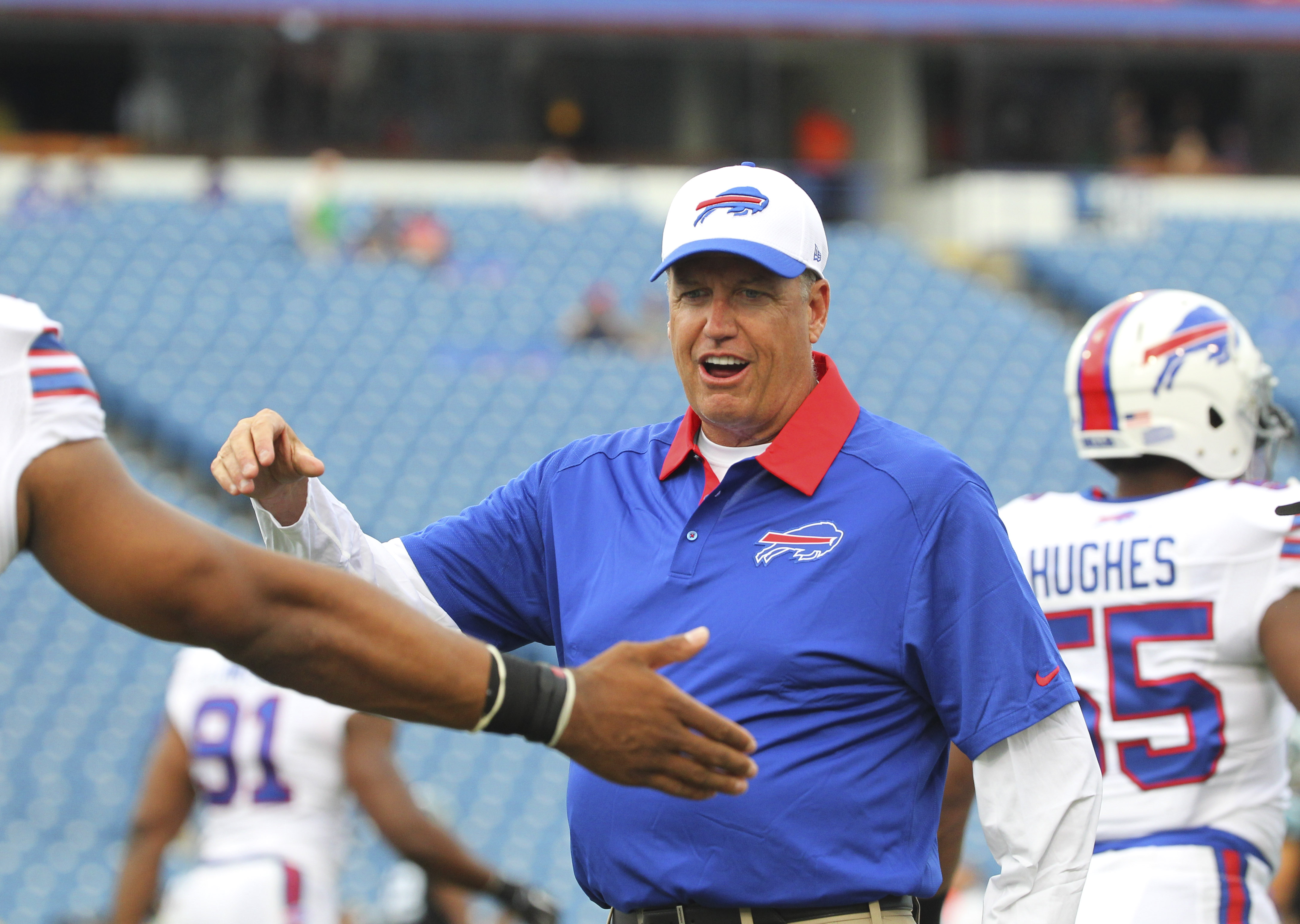 FILE - In this Aug. 14, 2015, file photo, Buffalo Bills coach Rex Ryan talks to players before an NFL preseason football game against the Carolina Panthers in Orchard Park, N.Y. Ryan has re-energized a franchise that has the longest playoff drought at 15