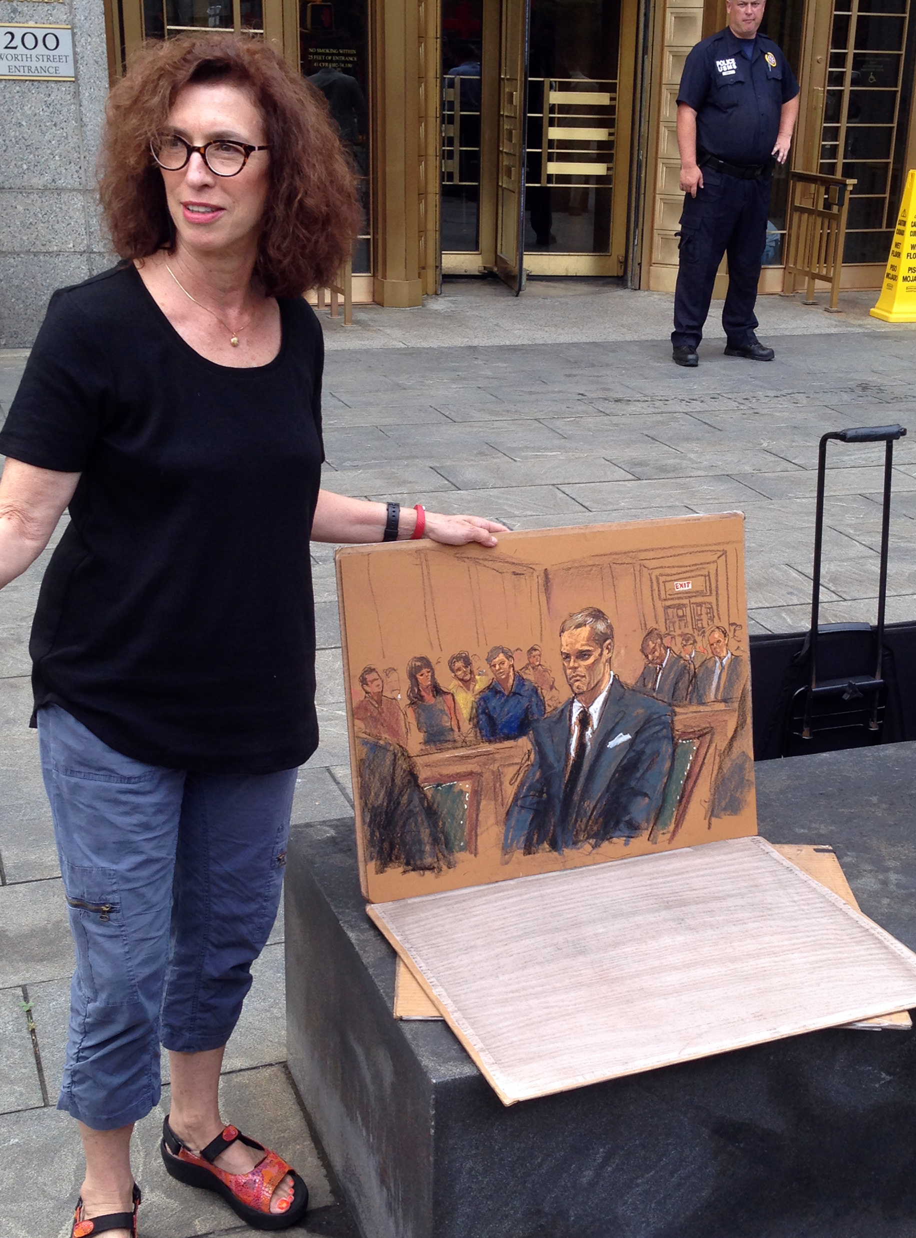 Courtroom sketch artist Jane Rosenberg displays her latest drawing of New England Patriots quarterback Tom Brady outside a federal courthouse in New York, Monday, Aug. 31, 2015. Rosenberg returned to court several weeks after her drawing at Brady's first