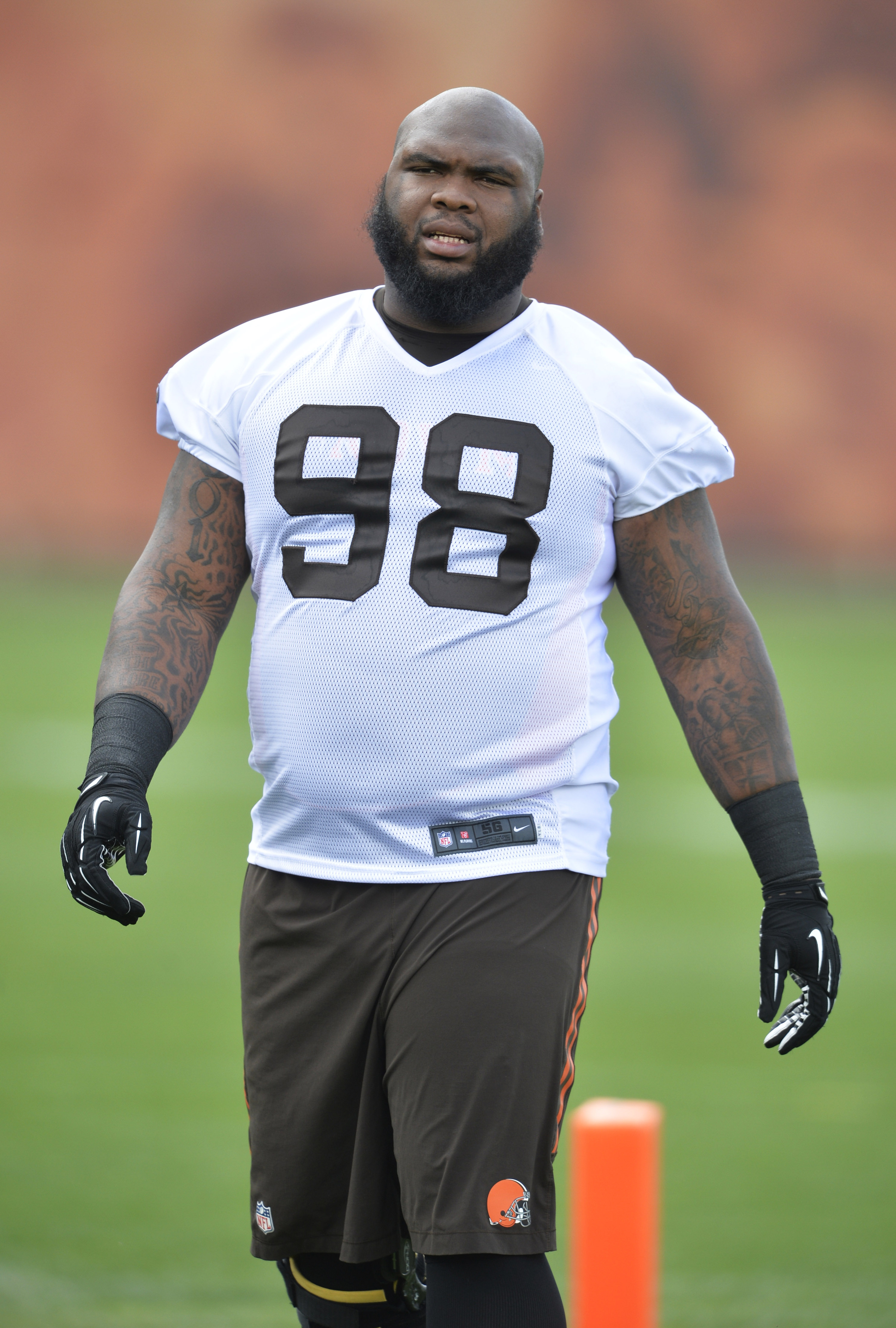 FILE - In this Tuesday, May 26, 2015 file photo, Cleveland Browns defensive lineman Phil Taylor (98) participates in an NFL organized training activity in Berea, Ohio. The Browns have released defensive tackle Phil Taylor, a former first-round pick, Tuesd