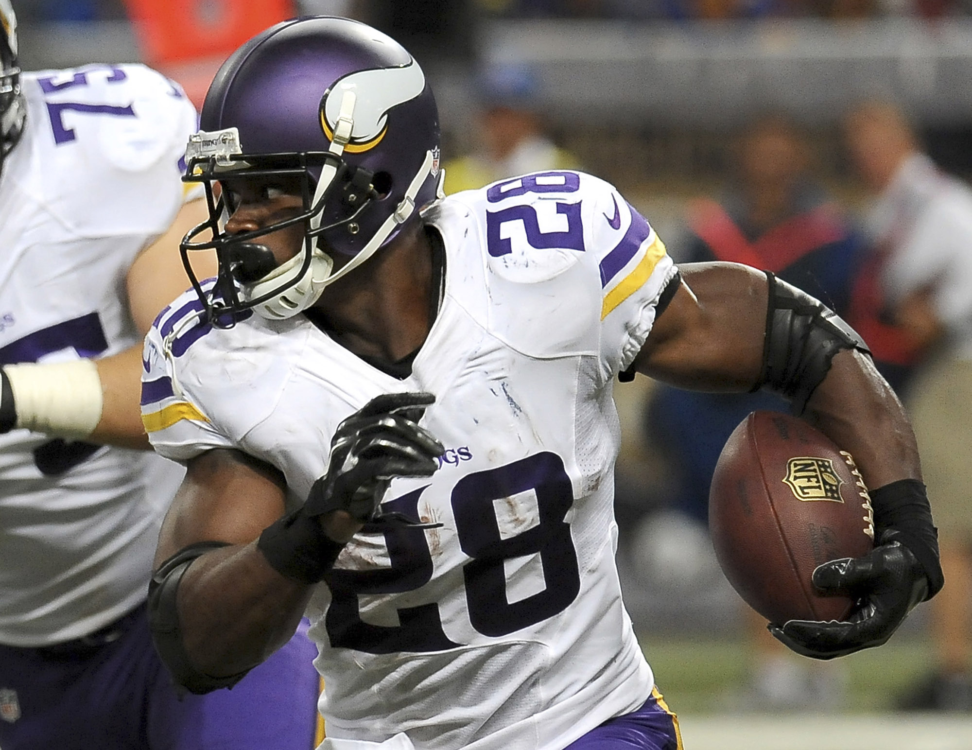 FILE - In this Sept. 7, 2014, file photo, Minnesota Vikings running back Adrian Peterson carries the ball agianst the St. Louis Rams during the third quarter an NFL football game in St. Louis. Peterson's return from the child abuse saga that sidelined him