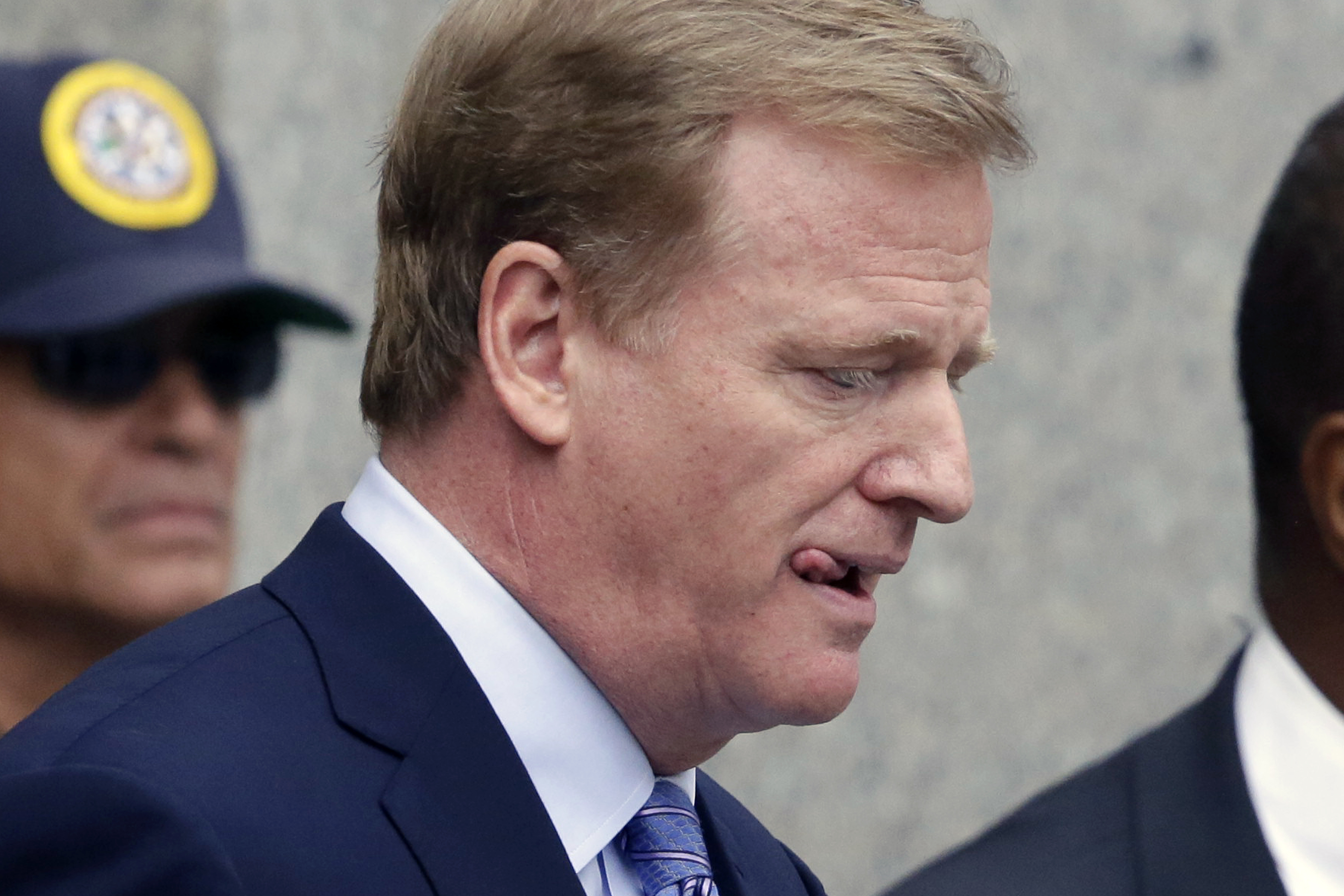 "FILE - In this Aug. 31, 2015, file photo, NFL Commissioner Roger Goodell leaves federal court Monday in New York. New England Patriots quarterback Tom Brady can suit up for his team's season opener after a judge erased his four-game suspension for ""Deflat"