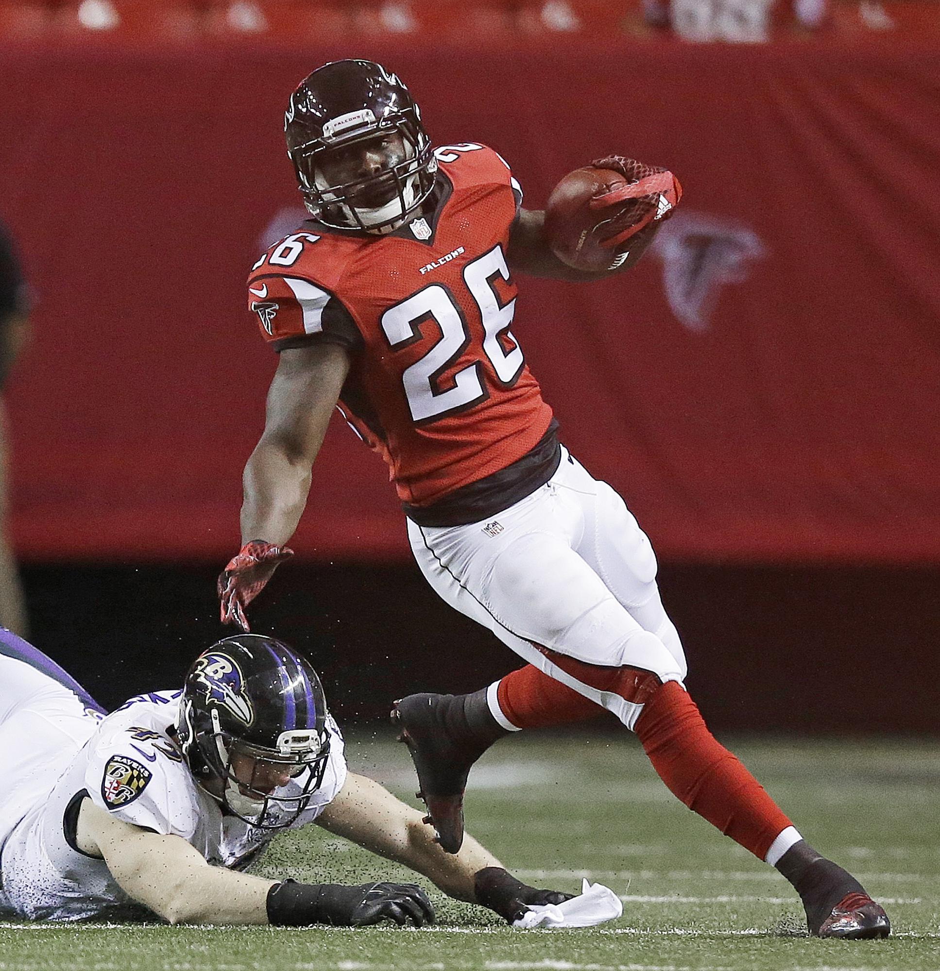 Atlanta Falcons running back Tevin Coleman (26) Baltimore Ravens linebacker Brennen Beyer (45) during the first half of an NFL football preseason game, Thursday, Sept. 3, 2015, in Atlanta. (AP Photo/Brynn Anderson )