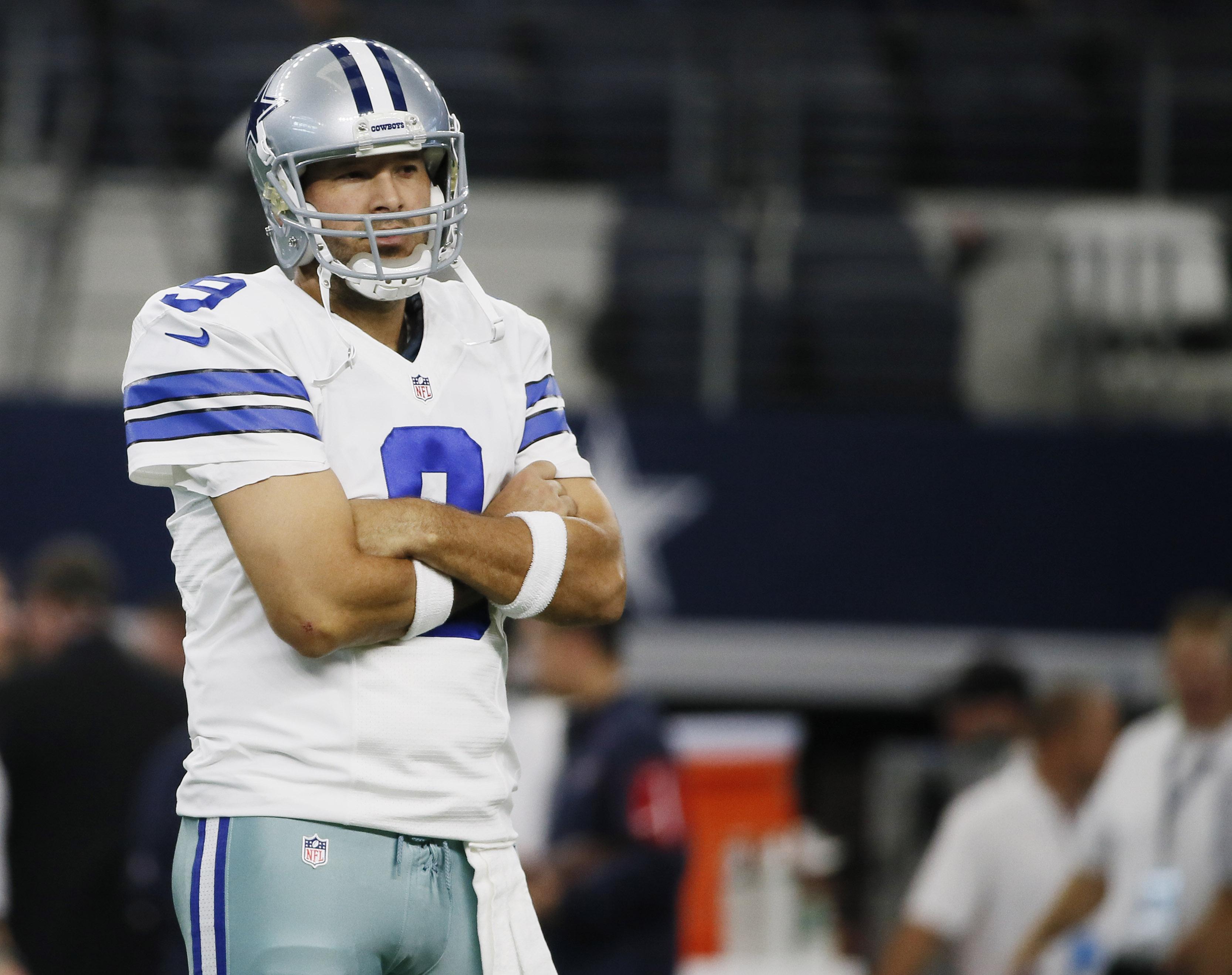 Dallas Cowboys quarterback Tony Romo (9) watches the team warm up before a preseason NFL football game against the Houston Texans, Thursday, Sept. 3, 2015, in Arlington, Texas. (AP Photo/Tony Gutierrez)