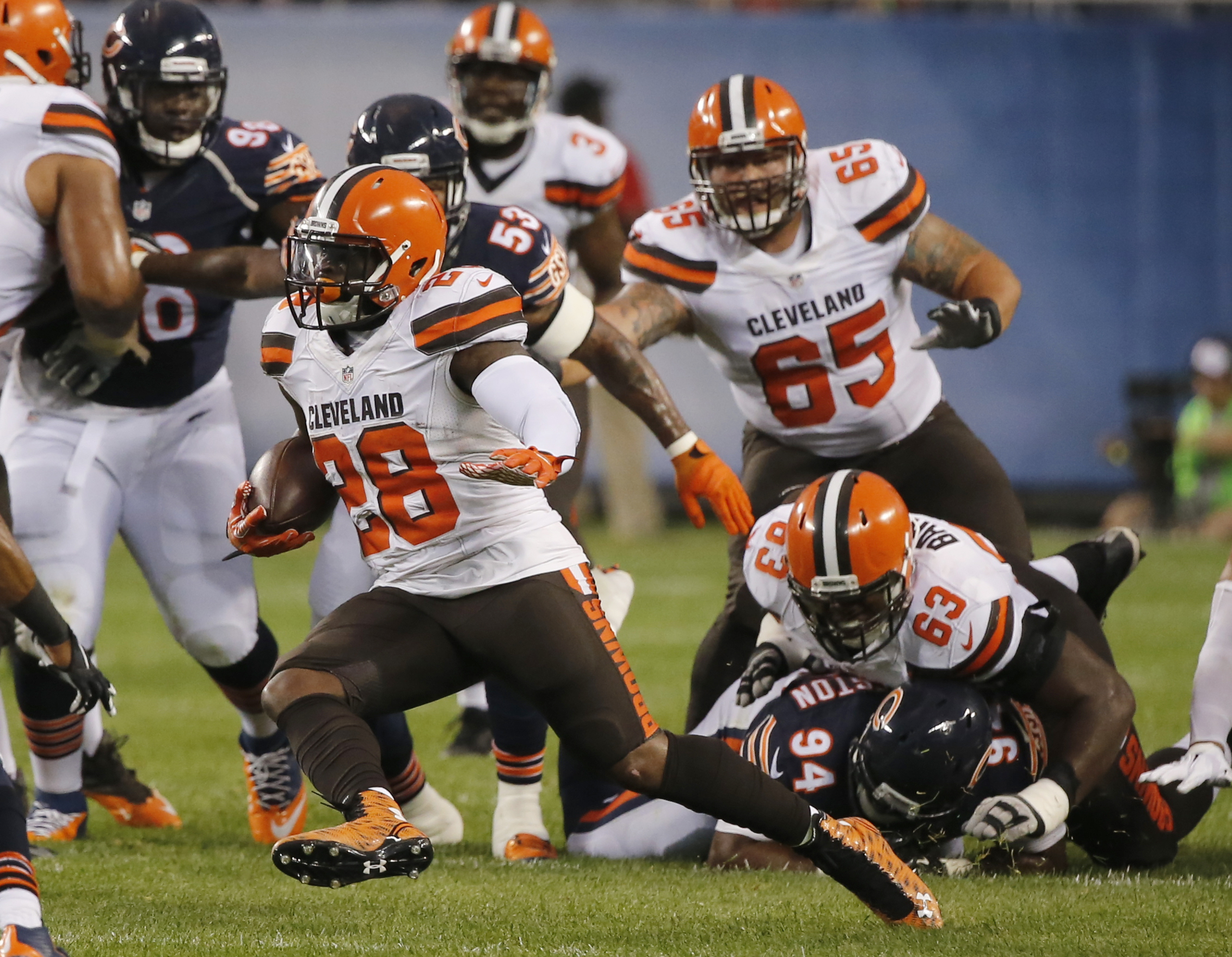 Cleveland Browns running back Terrance West (28) runs against Chicago Bears defense during the first half of an NFL preseason football game, Thursday, Sept. 3, 2015, in Chicago. (AP Photo/Charles Rex Arbogast)