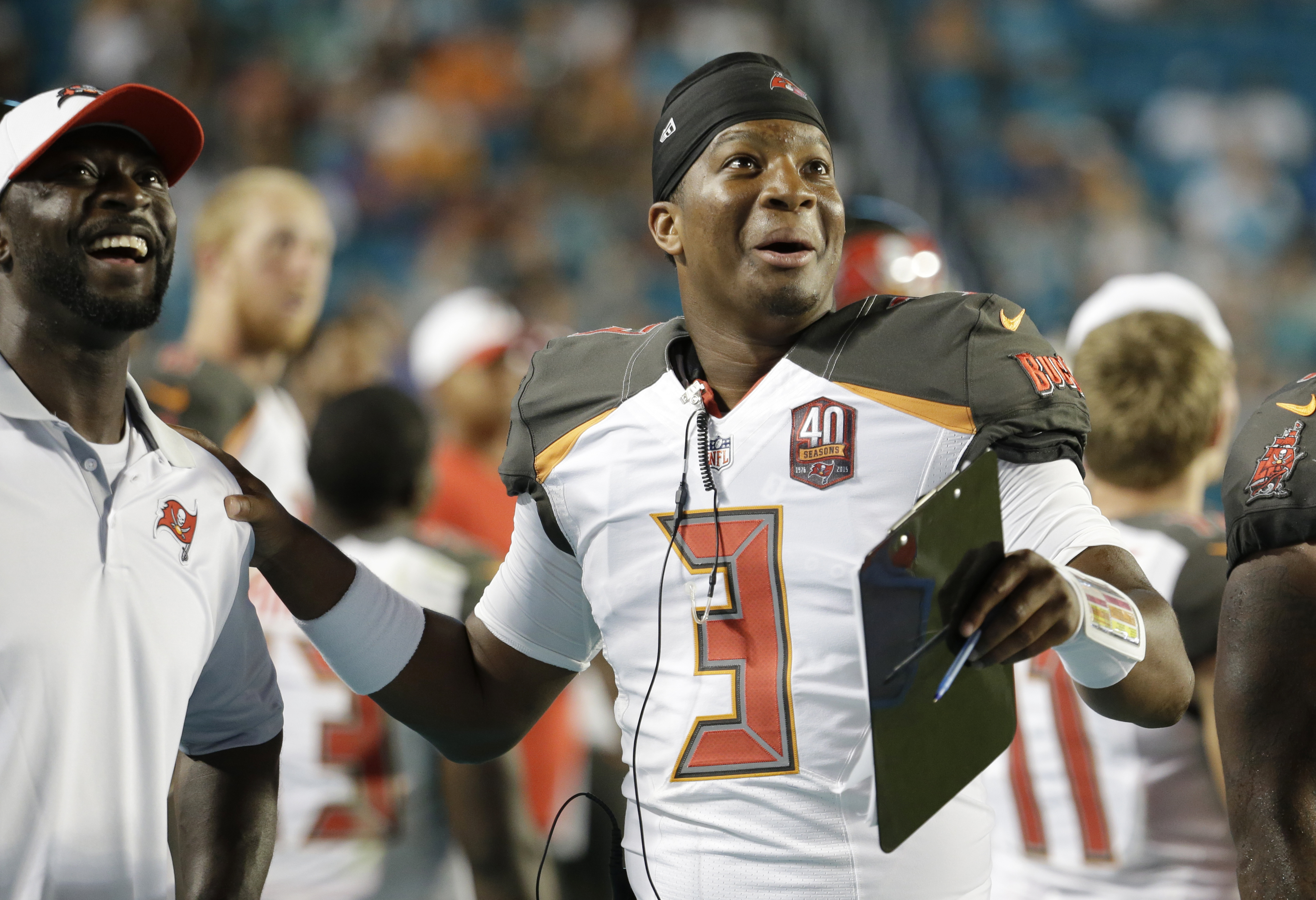 Tampa Bay Buccaneers quarterback Jameis Winston (3) watches a game replay during the second half of an NFL preseason football game against the Miami Dolphins, Thursday, Sept. 3, 2015, in Miami Gardens, Fla. (AP Photo/Lynne Sladky)