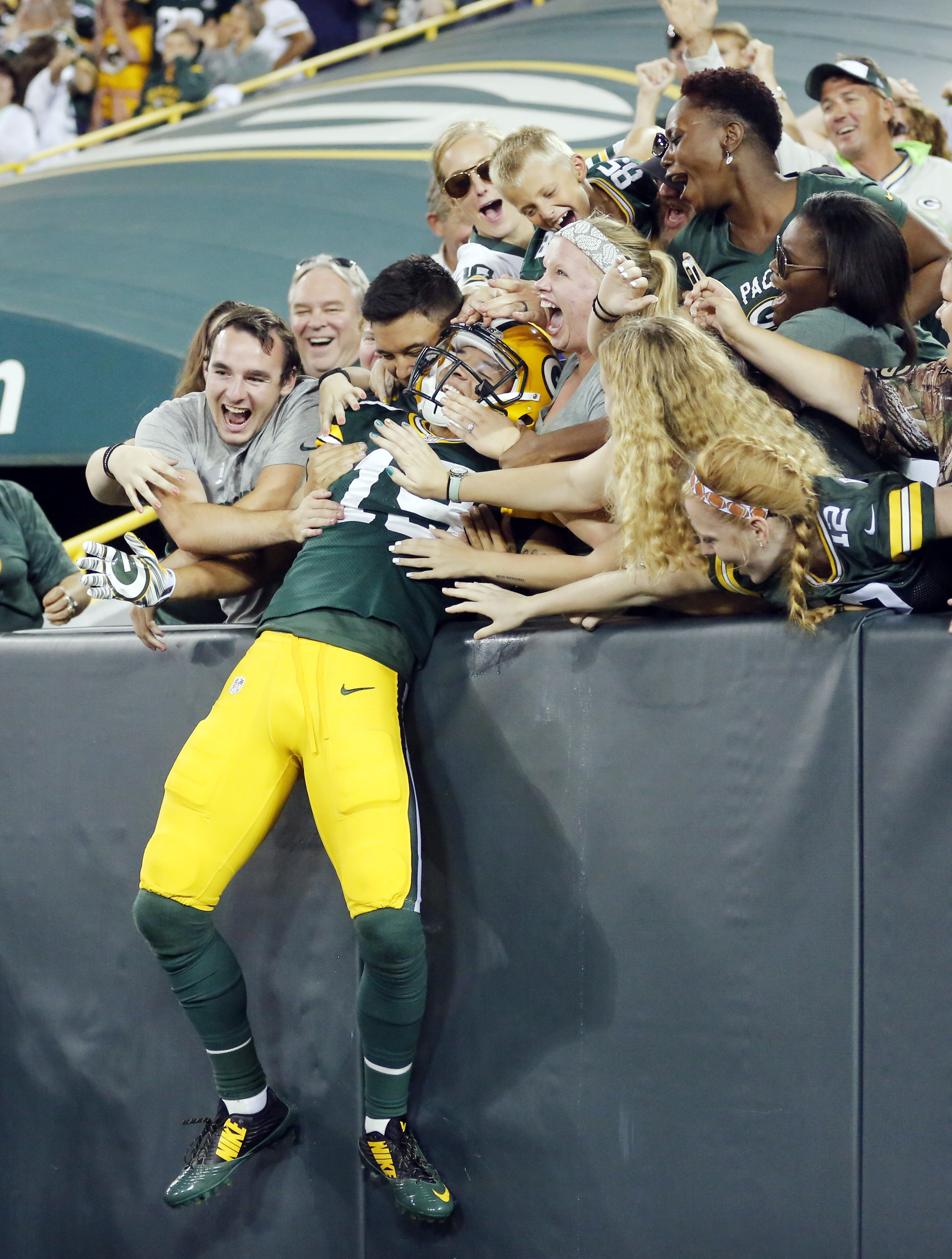 Green Bay Packers' Myles White celebrates his touchdown catch with fans during the second half of an NFL preseason football game against the New Orleans Saints Thursday, Sept. 3, 2015, in Green Bay, Wis. (AP Photo/Jeffrey Phelps)