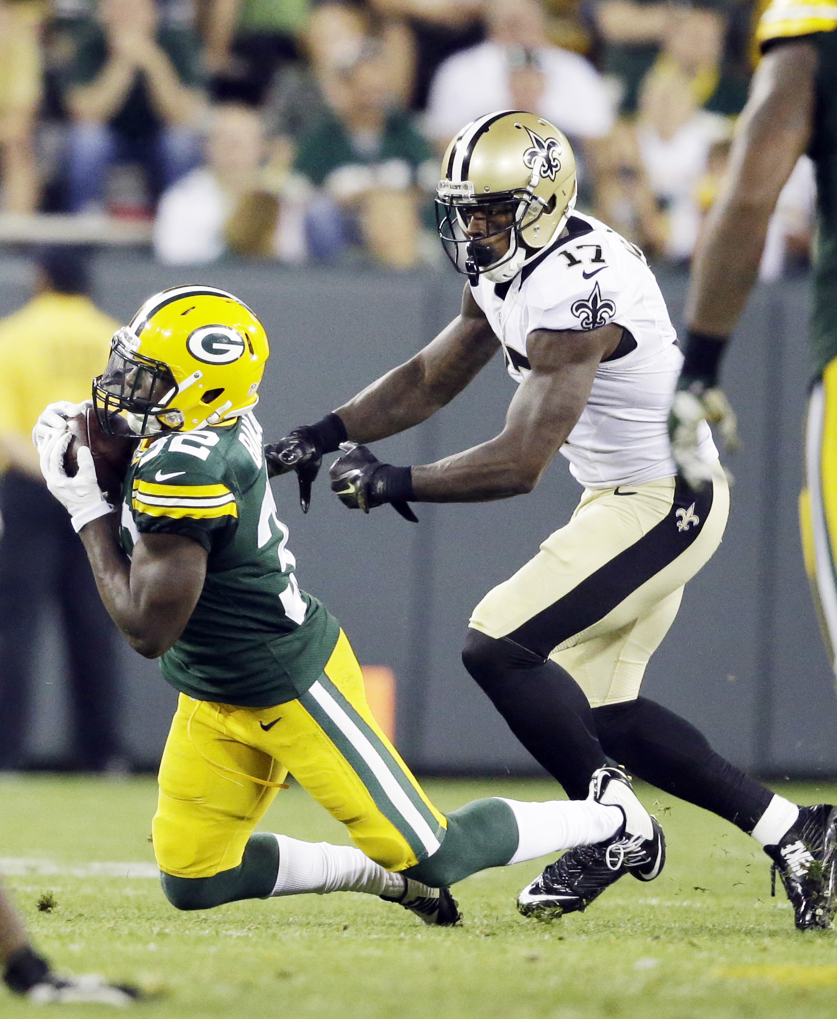 Green Bay Packers' Chris Banjo intercepts a pass in front of New Orleans Saints' Josh Morgan (17) during the second half of an NFL preseason football game Thursday, Sept. 3, 2015, in Green Bay, Wis. The Packers won 38-10. (AP Photo/Jeffrey Phelps)