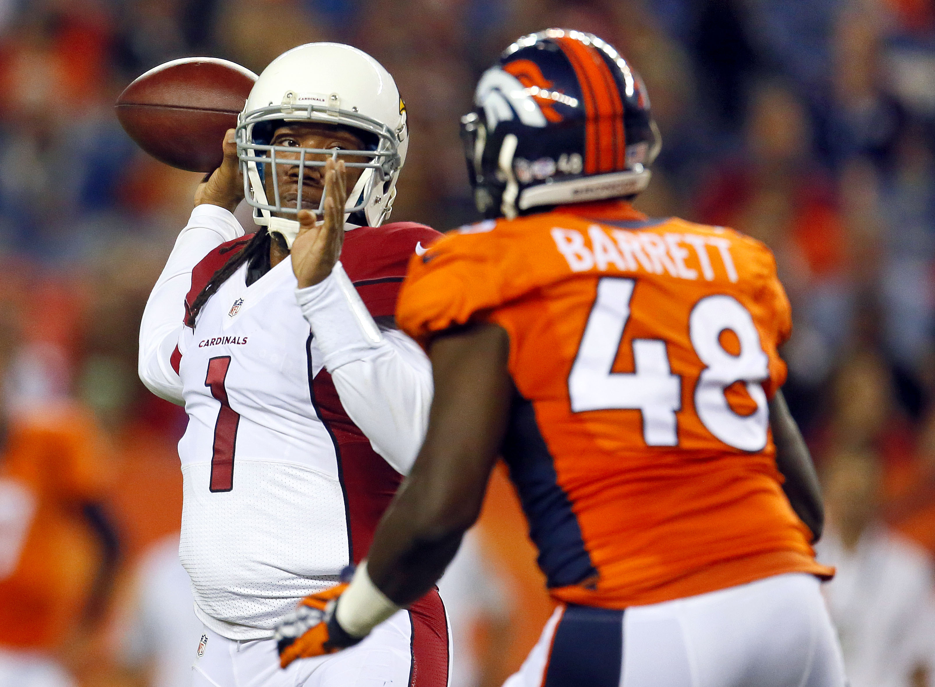 Arizona Cardinals quarterback Phillip Sims (1) throws over Denver Broncos linebacker Shaquil Barrett (48) during the first half of an NFL preseason football game, Thursday, Sept. 3, 2015, in Denver. (AP Photo/Joe Mahoney)