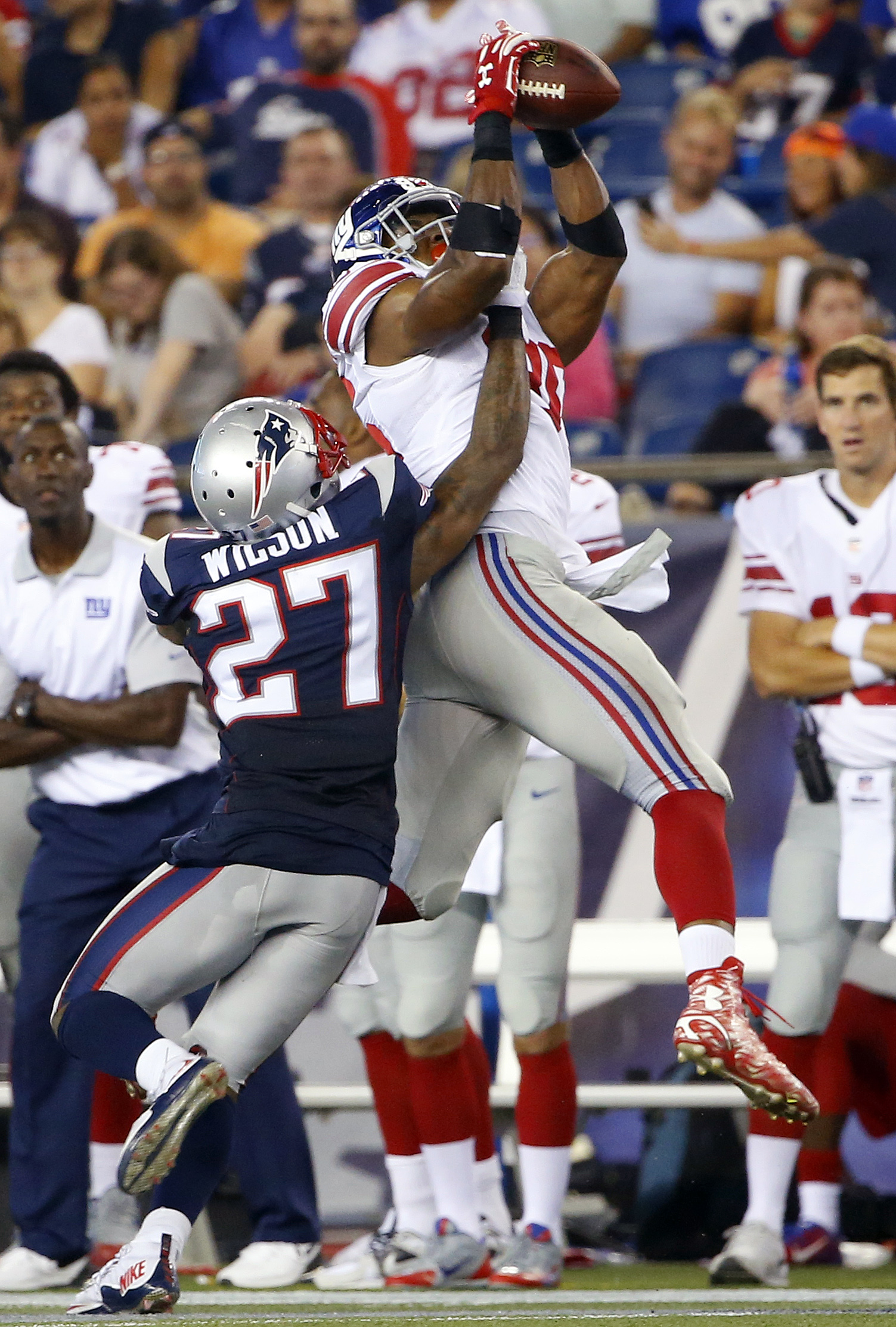 New York Giants tight end Jerome Cunningham, rear, catches a pass over New England Patriots strong safety Tavon Wilson (27) in the second half of an NFL football game Thursday, Sept. 3, 2015, in Foxborough, Mass. (AP Photo/Winslow Townson)