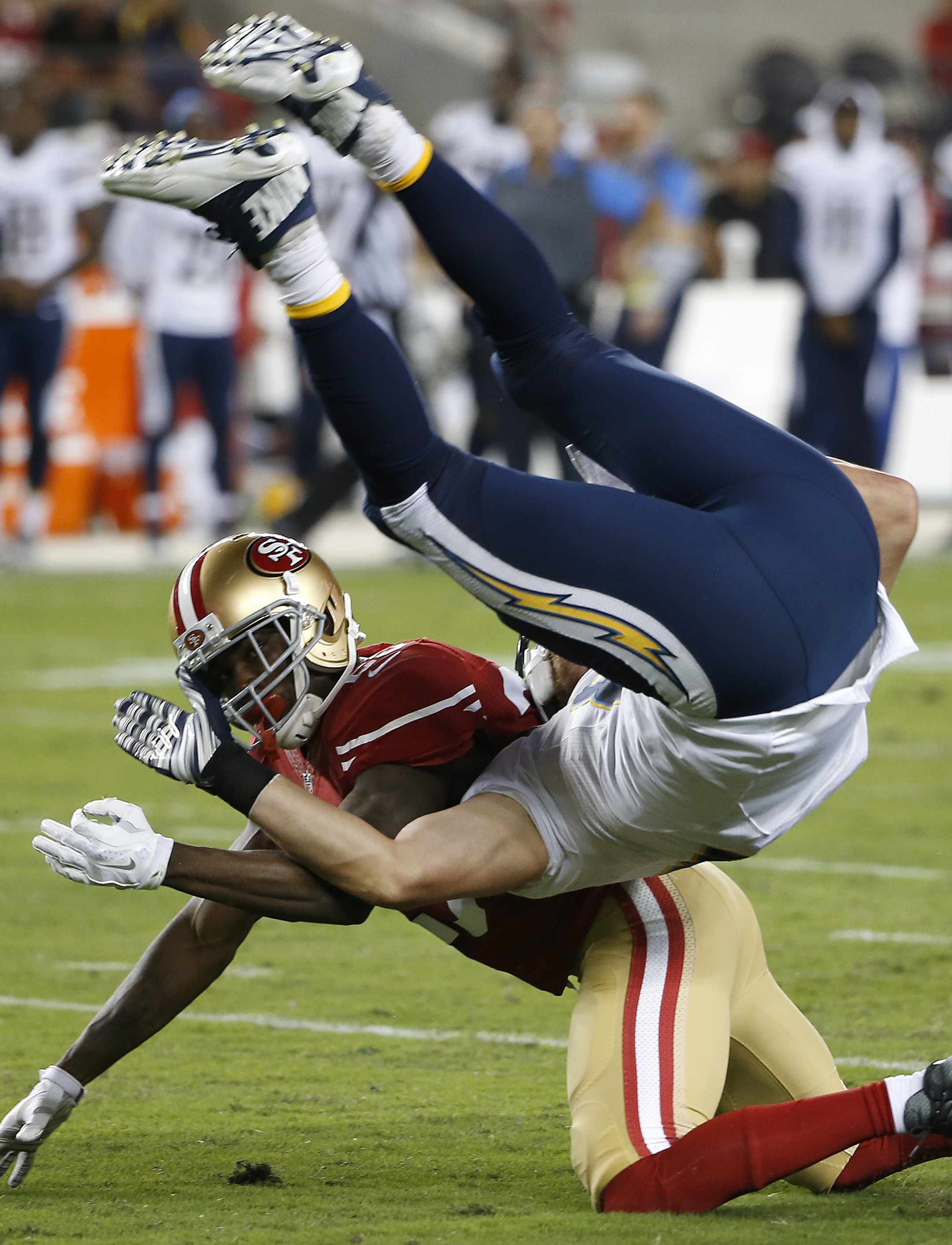San Diego Chargers tight end John Phillips, top, falls over San Francisco 49ers strong safety Jimmie Ward during the first half of an NFL preseason football game in Santa Clara, Calif., Thursday, Sept. 3, 2015. (AP Photo/Tony Avelar)