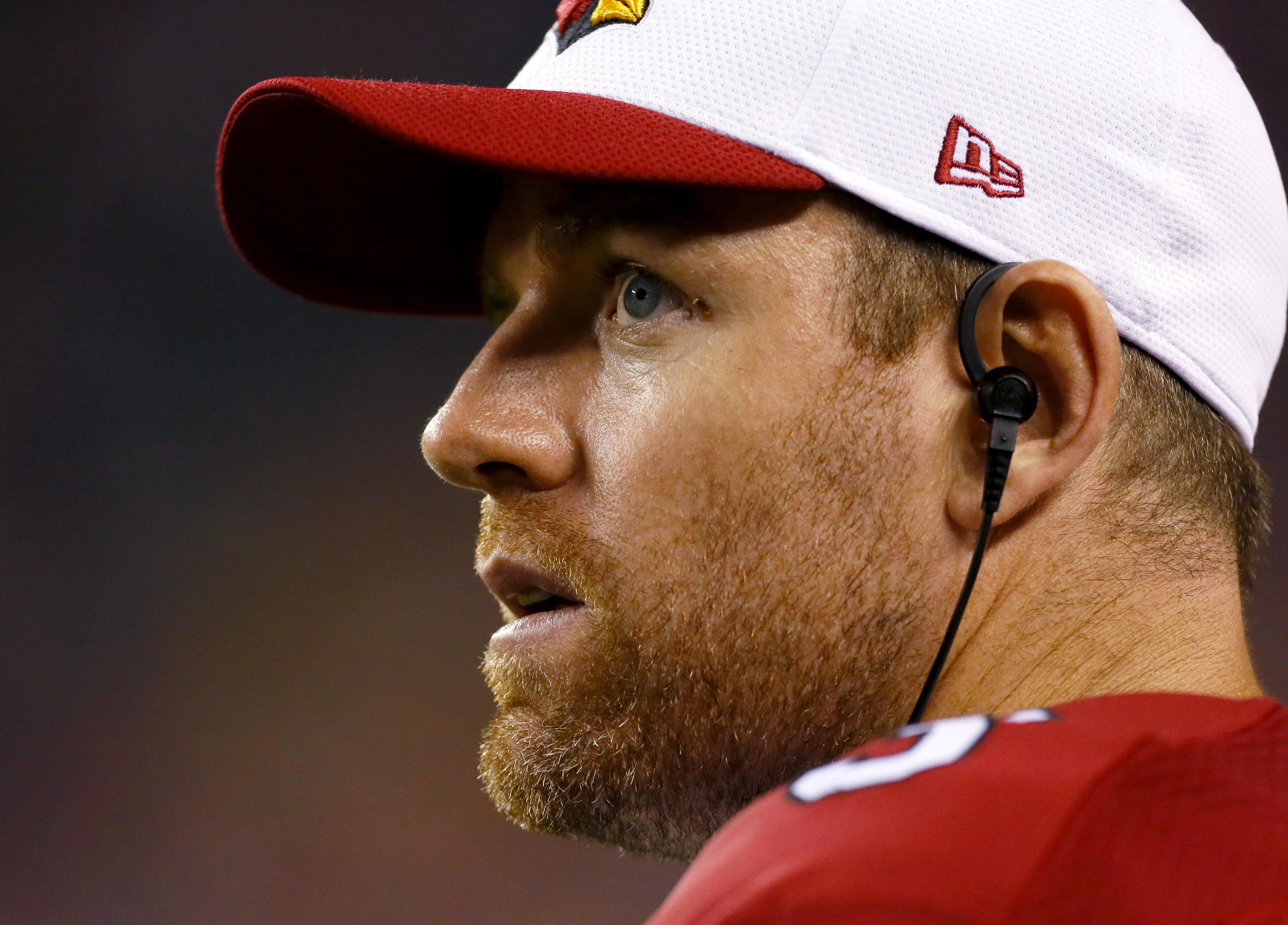 Arizona Cardinals quarterback Carson Palmer stands on the sidelines during the second half of an NFL preseason football game against the Denver Broncos, Thursday, Sept. 3, 2015, in Denver. The Cardinals won 22-20. (AP Photo/Joe Mahoney)