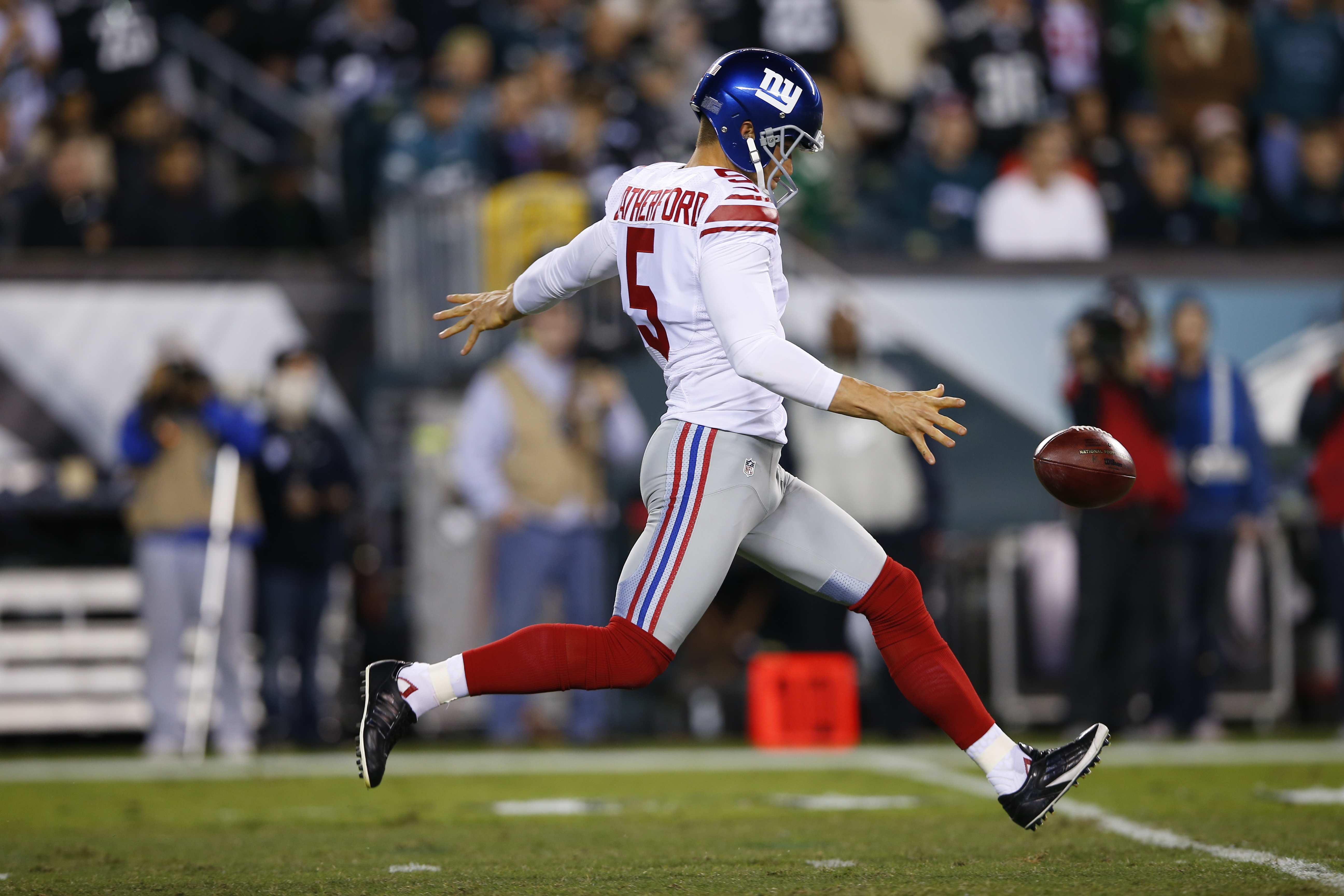 FILE - In this Oct. 12, 2014, file photo, New York Giants' Steve Weatherford punts during the second half of an NFL football game against the Philadelphia Eagles in Philadelphia. The Giants released popular punter Steve Weatherford on Friday, Sept. 4, 201