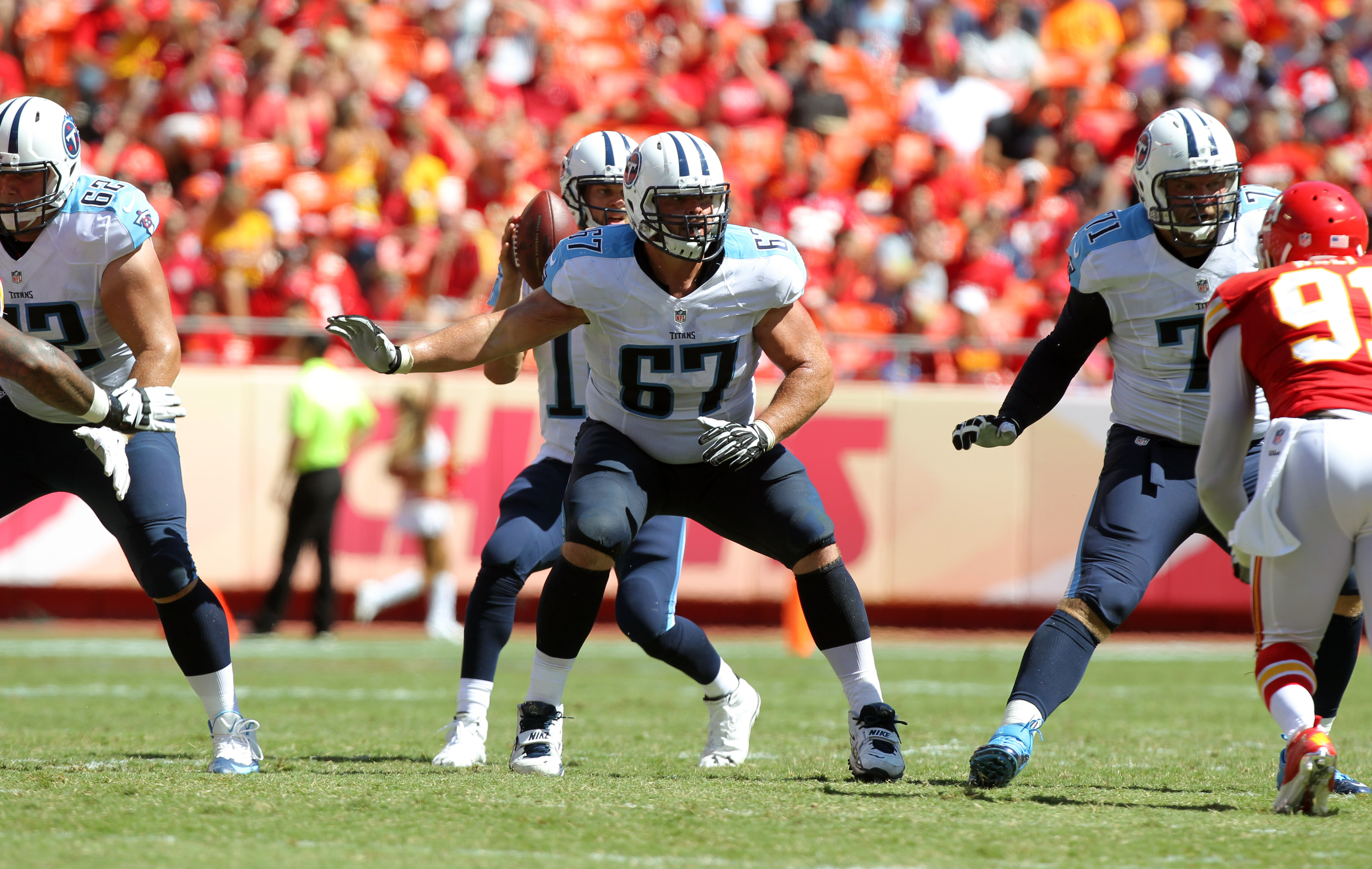 FILE - In this Sept. 7, 2014, file photo, Tennessee Titans guard Andy Levitre (67) blocks during an NFL football game against the Kansas City Chiefs in Kansas City, Mo. The Atlanta Falcons have traded with the Titans for veteran guard Andy Levitre in exch