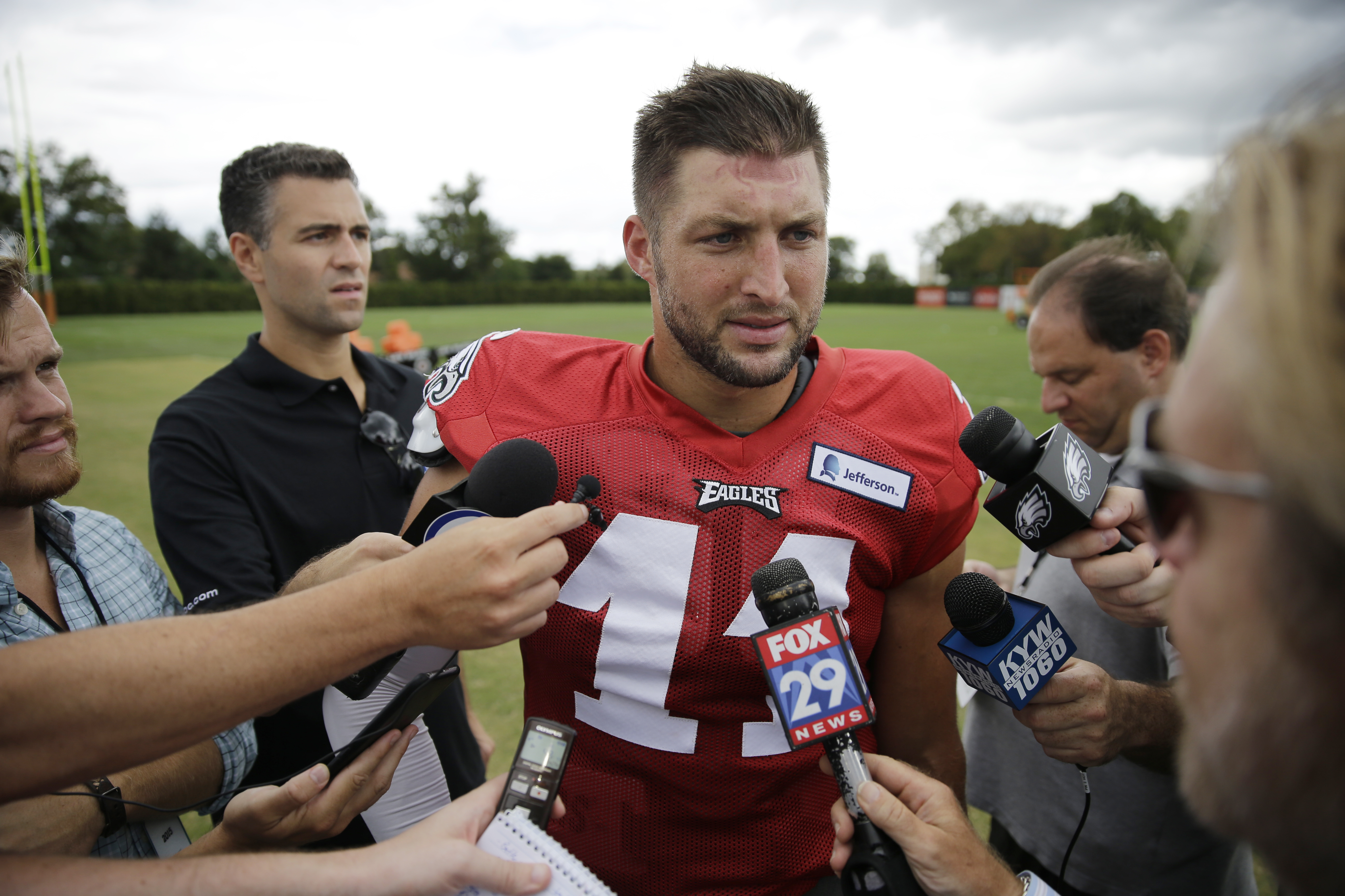 FILE - In this Aug. 20, 2015, file photo, Philadelphia Eagles quarterback Tim Tebow speaks with members of the media after NFL football training camp in Philadelphia. Two people familiar with the move say the Eagles released Tebow. Both sources spoke on c