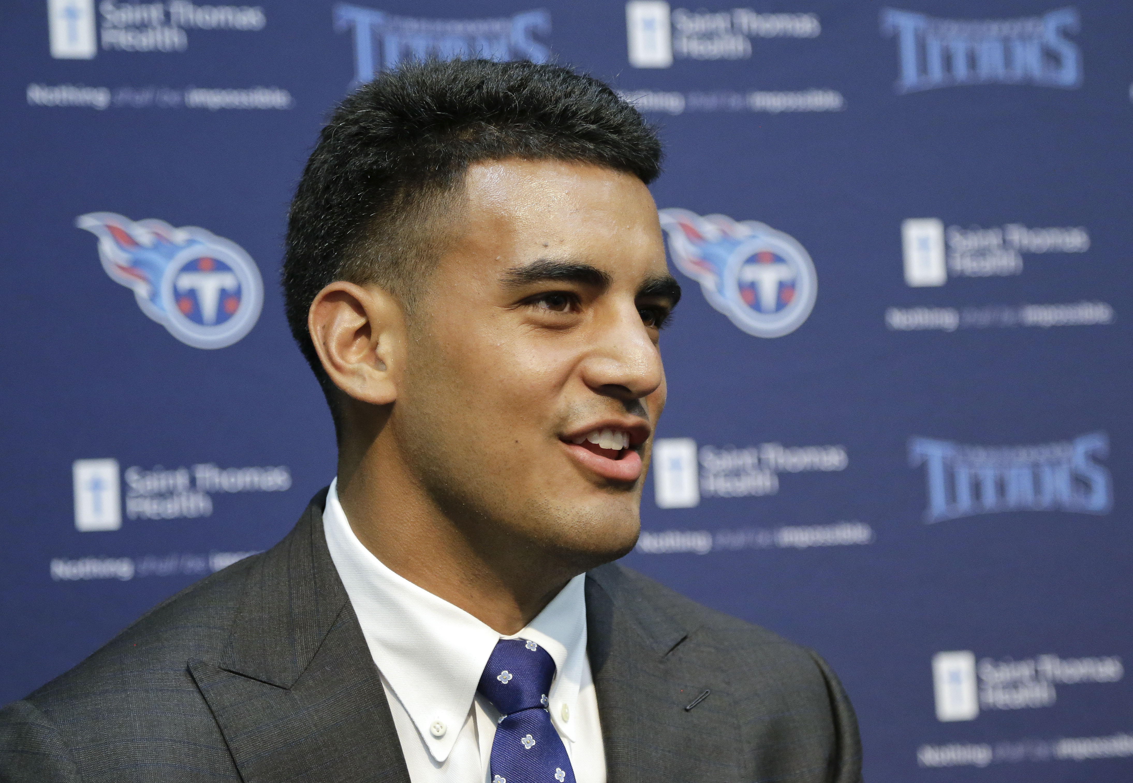 FILE - In this May 1, 2015, file photo, Marcus Mariota, selected second at the NFL Draft by the Tennessee Titans, answers questions during a news conference in Nashville, Tenn. Jameis Winston and Mariota became the sixth pair of quarterbacks drafted 1-2 o