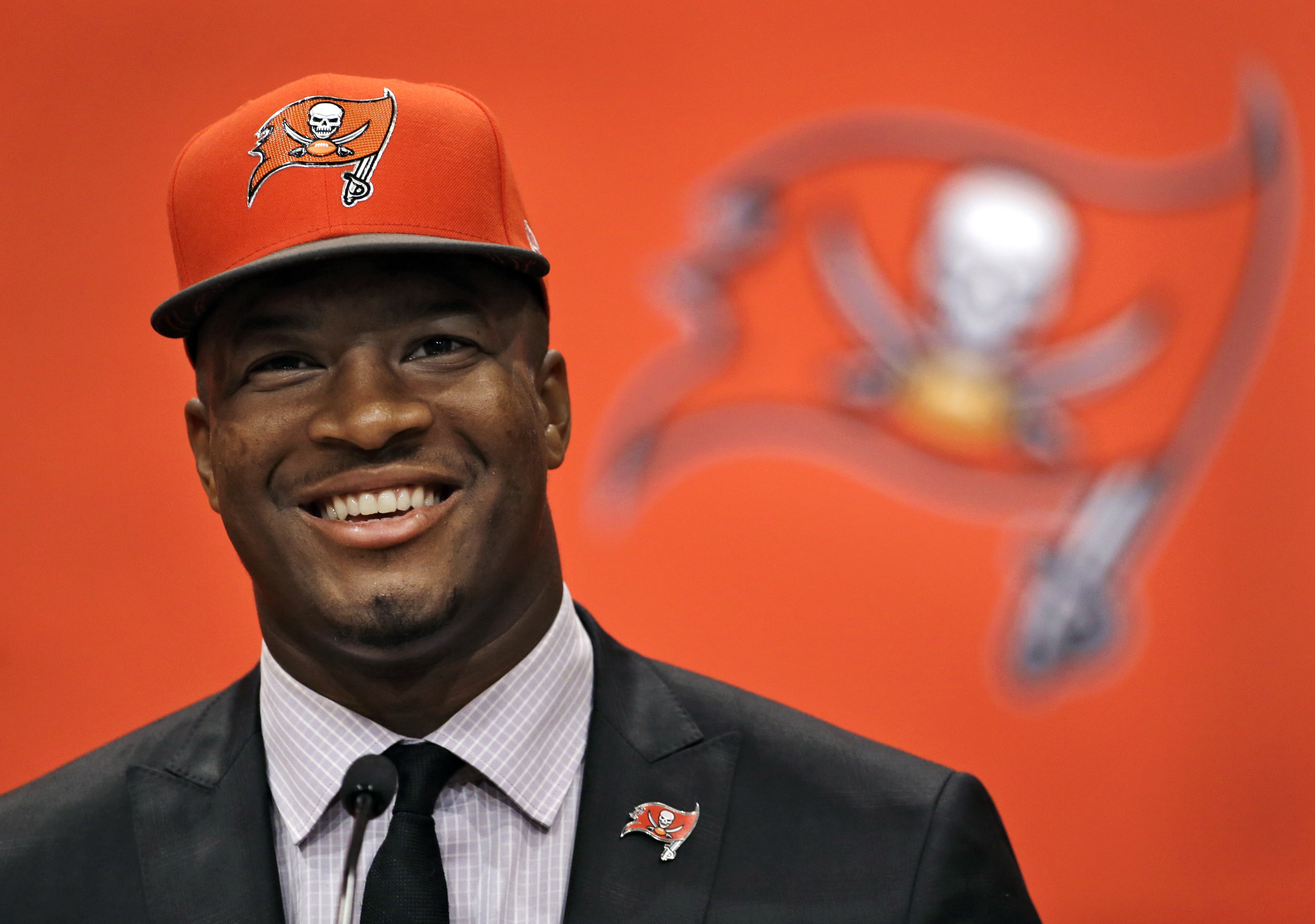 FILE - In this May 1, 2015, file photo, Jameis Winston, selected as the No.1 overall pick in the NFL draft by the Tampa Bay Buccaneers, smiles during a news conference in Tampa, Fla. Winston and Marcus Mariota became the sixth pair of quarterbacks drafted