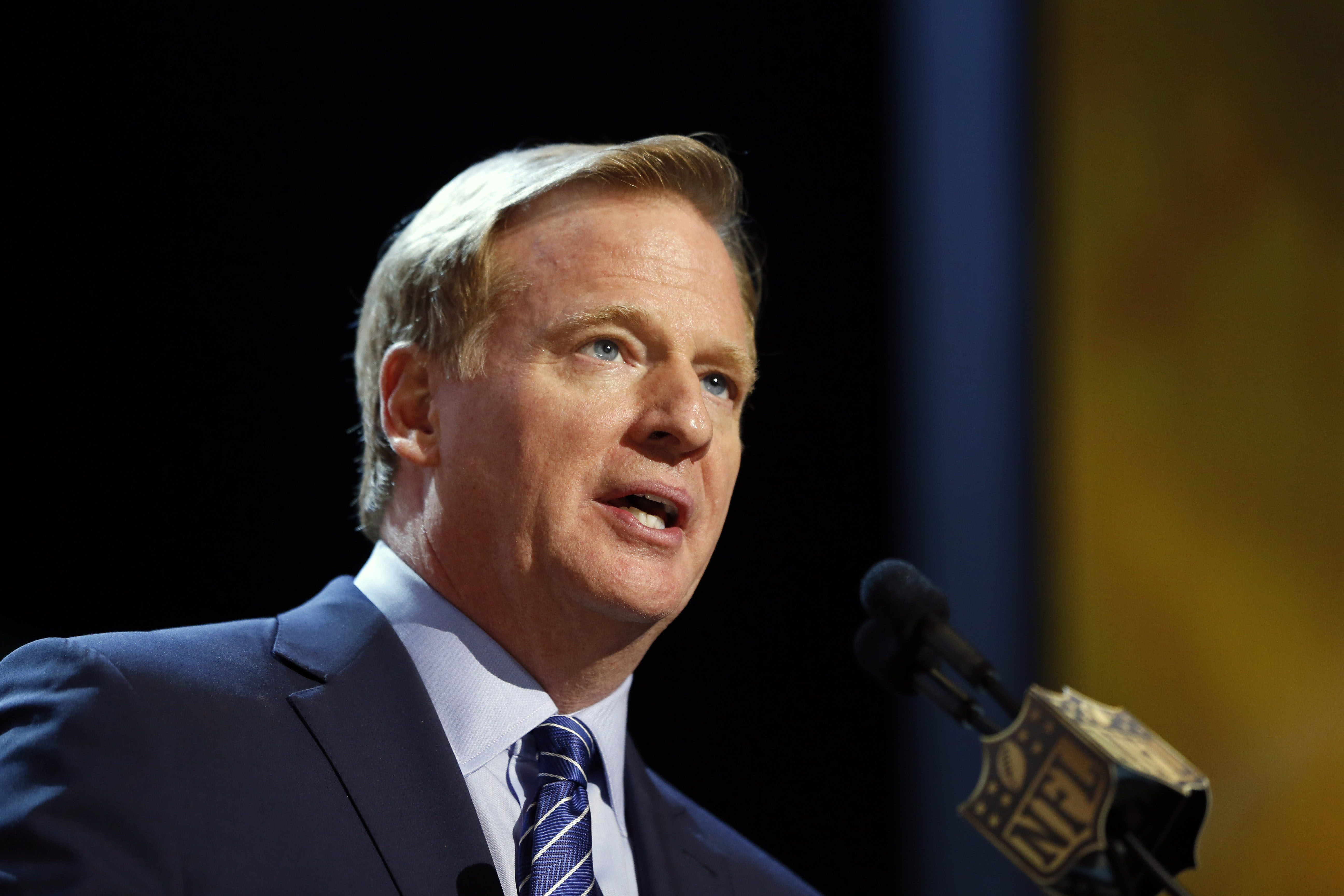 FILE - In this Thursday, April 30, 2015 file photo, NFL commissioner Roger Goodell speaks during the first round of the 2015 NFL Football Draft in Chicago. Without the games to distract from the issues, football fans were left to ponder the NFL's policies