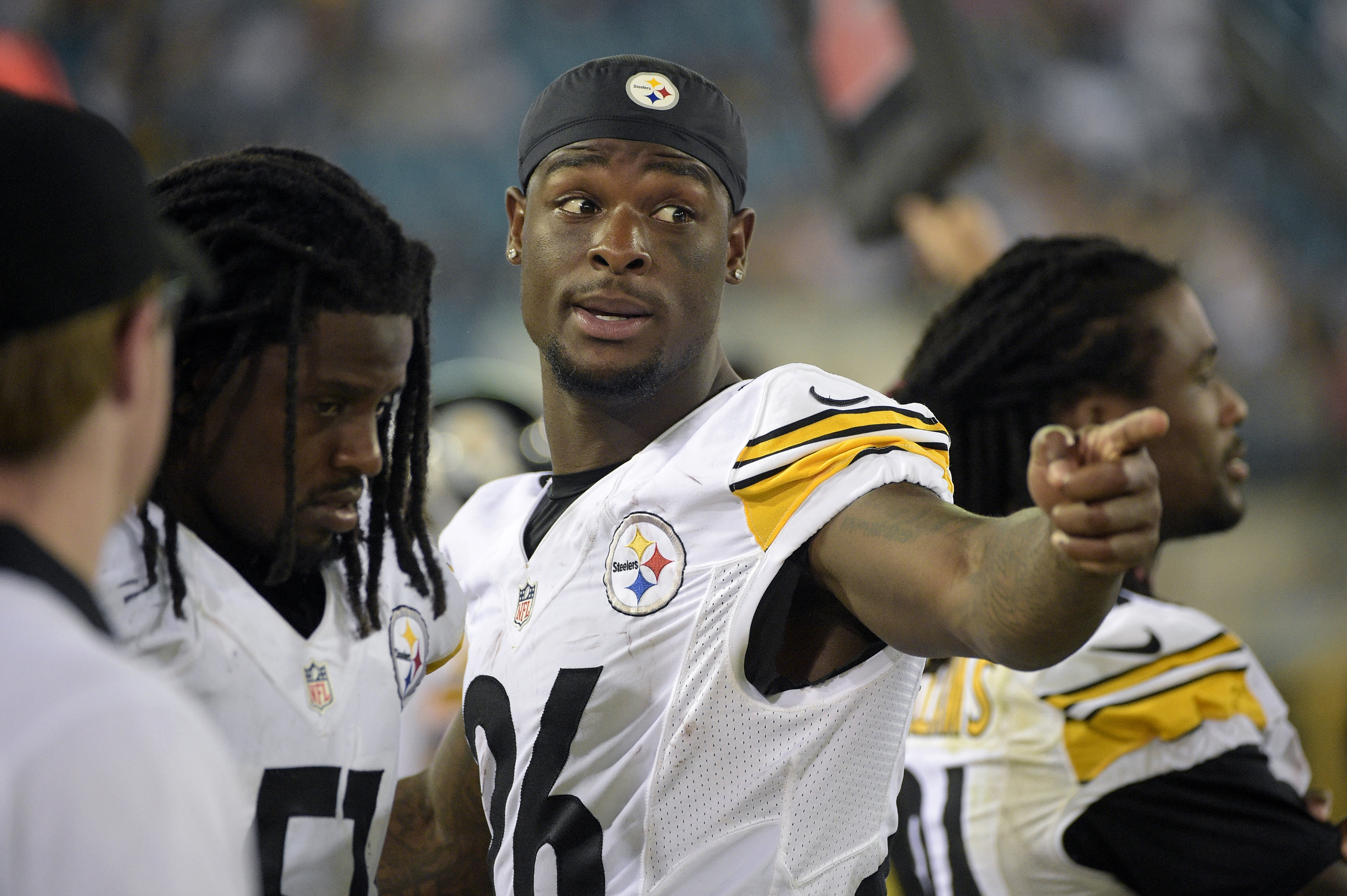 FILE - In this Aug. 14, 2015, file photo,Pittsburgh Steelers running back Le'Veon Bell, center, gestures on the sideline during the second half of an NFL preseason football game against the Jacksonville Jaguars in Jacksonville, Fla. Several teams will be