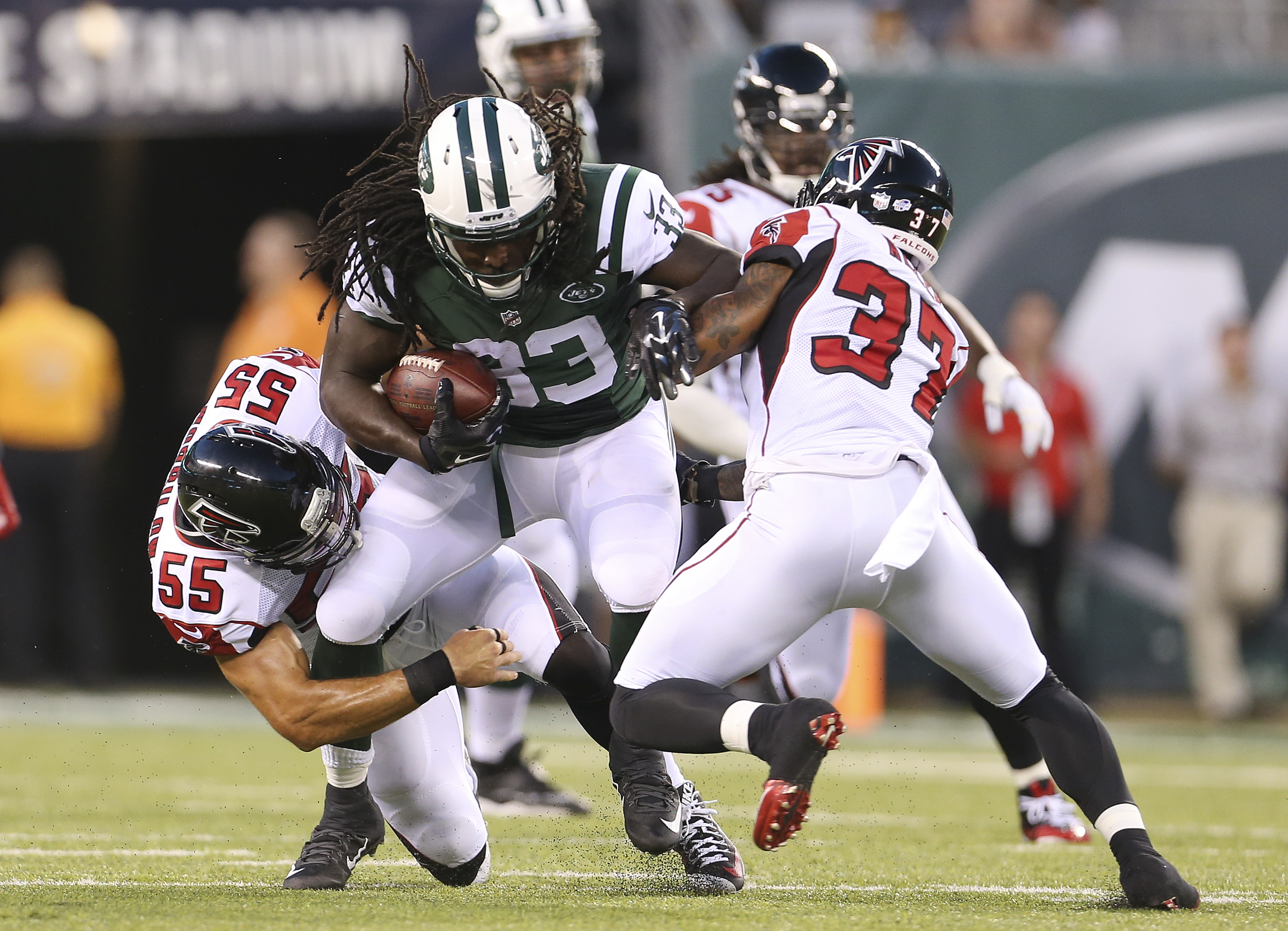 FILE - In this Aug. 21, 2015, file photo, Atlanta Falcons' Paul Worrilow (55) and Ricardo Allen (37) tackle New York Jets' Chris Ivory (33) during the first half of a preseason NFL football game in East Rutherford, N.J. Ivory is a possible breakthrough fo