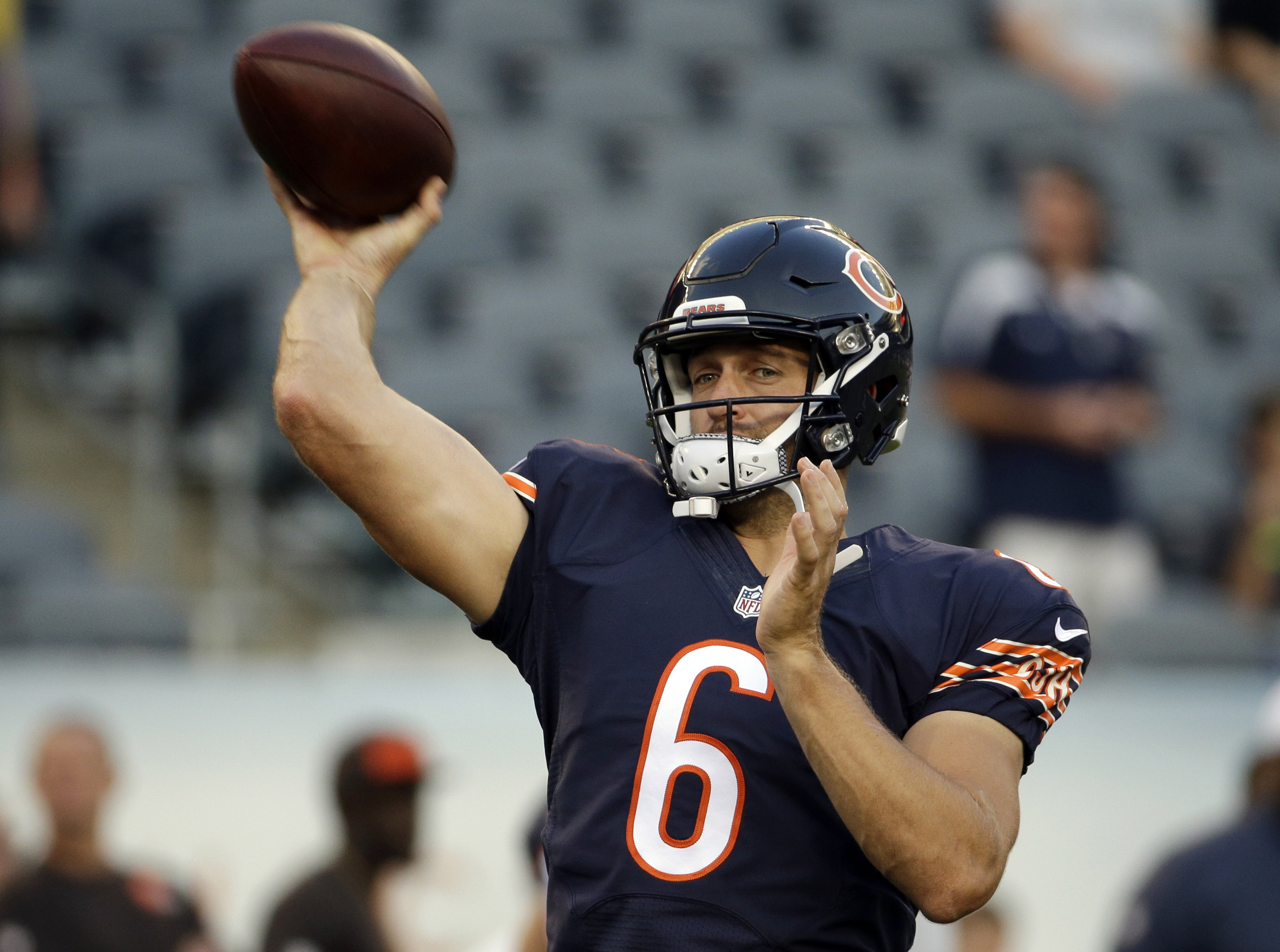 FILE - In this Sept. 3, 2015 file photo, Chicago Bears quarterback Jay Cutler warms up before an NFL preseason football game against the Cleveland Browns in Chicago. Cutler and the Bears open the regular season Sunday, Sept. 13 hosting the Green Bay Packe