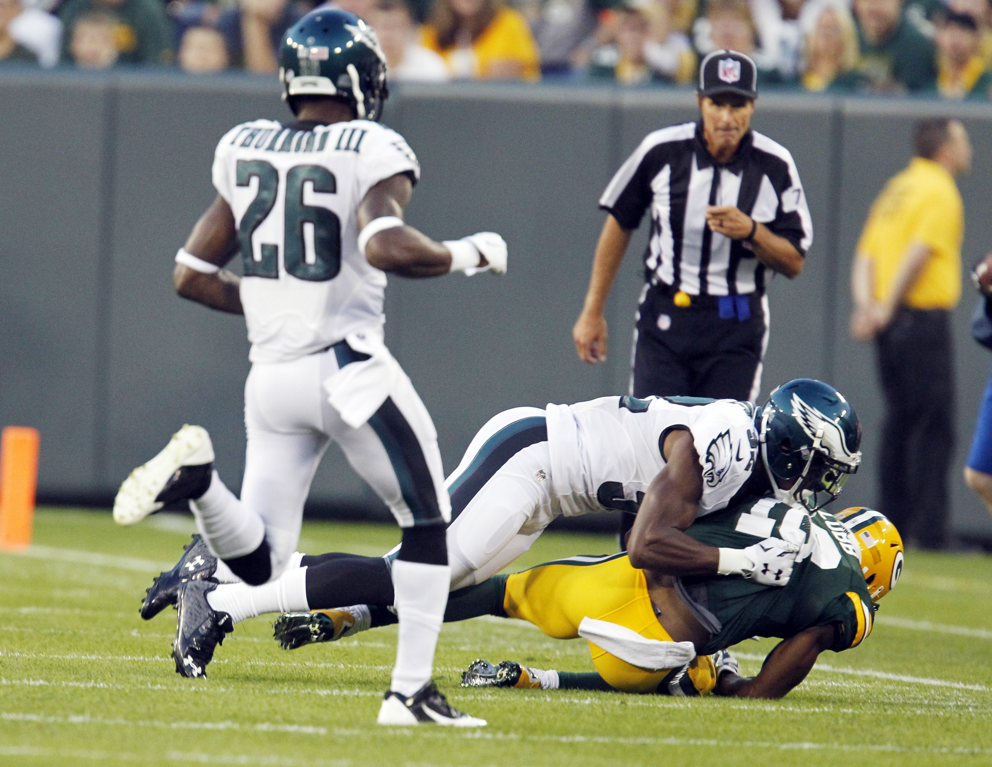 FILE - In this Aug. 29, 2015, file photo, Green Bay Packers' Randall Cobb is knocked down after going up for a pass during the first half of an NFL football game against the Philadelphia Eagles, in Green Bay, Wis. Cobb left the field after the play.  Cobb
