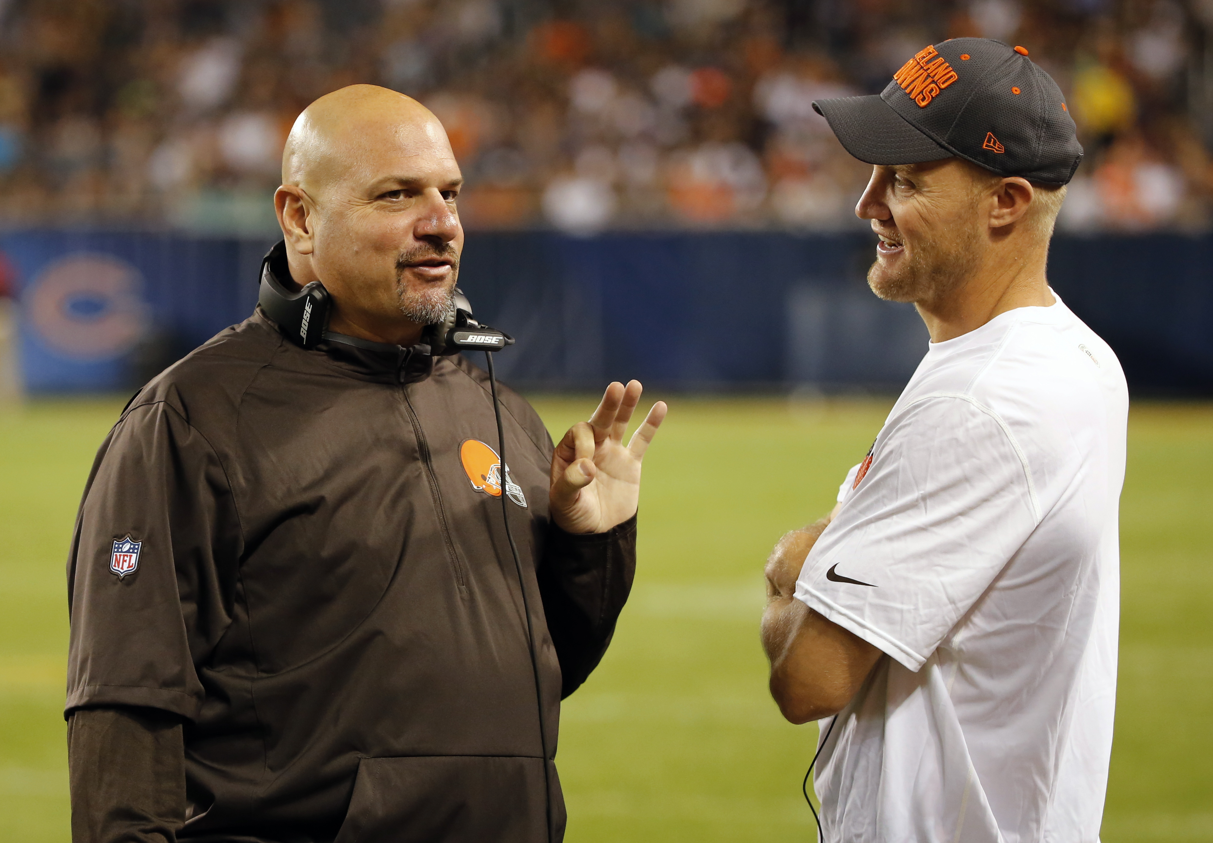 FILE - In this Sept. 3, 2015, file phto, Cleveland Browns head coach Mike Pettine talks to Cleveland Browns quarterback Josh McCown during the second half of an NFL preseason football game against the Chicago Bears in Chicago. At 36, Browns quarterback Jo
