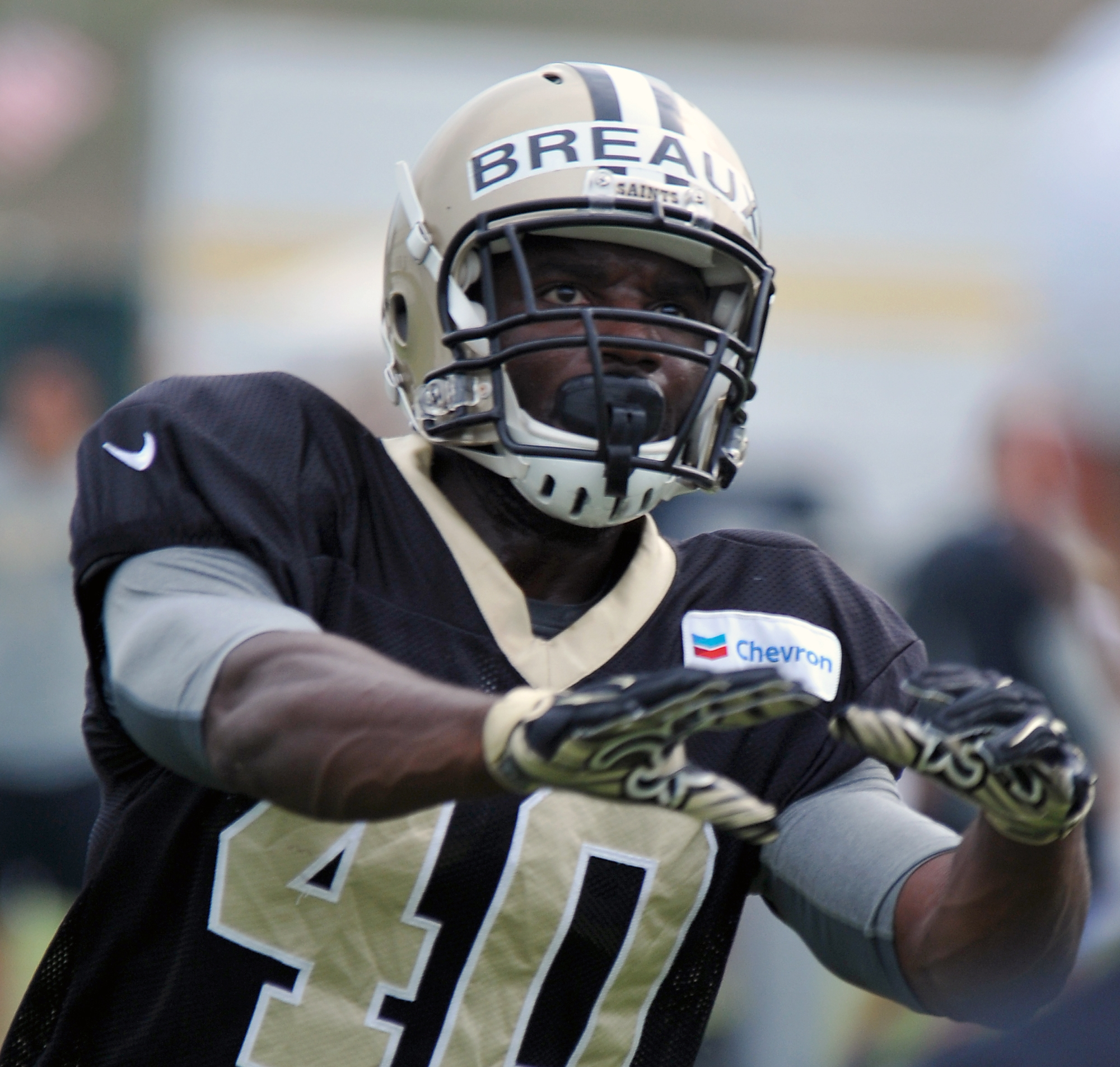 FILE - In this Aug. 6, 2015, file photo, New Orleans Saints defensive back Delvin Breaux (40) reaches for the ball during the team's NFL football training camp in White Sulphur Springs, W. Va. Nearly nine years after breaking his neck in a high school foo