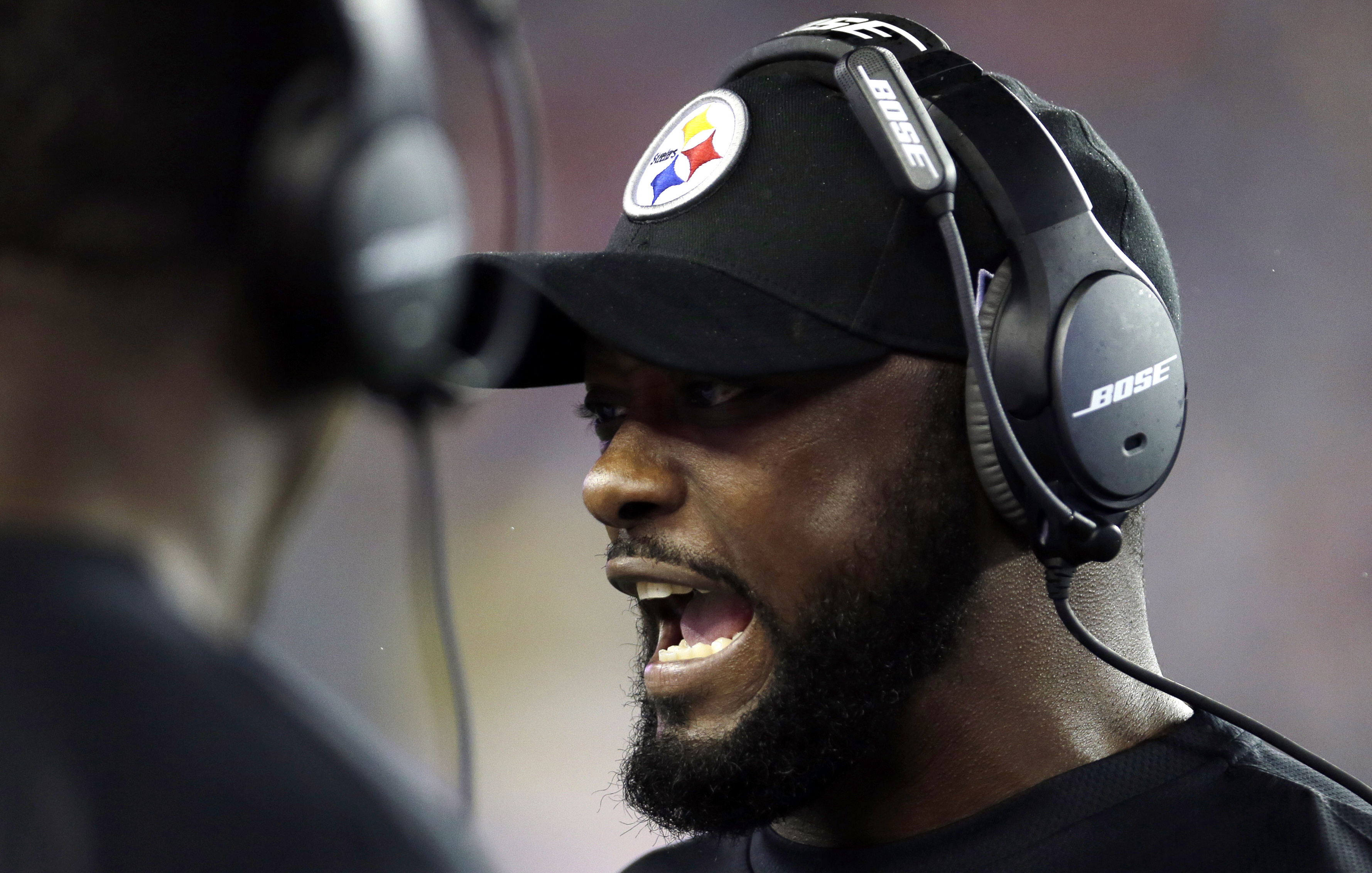 In this photo taken Thursday, Sept. 10, 2015, Pittsburgh Steelers head coach Mike Tomlin speaks to his team on the sideline in the second half of an NFL football game against the New England Patriots in Foxborough, Mass. New England Patriots coach Bill Be