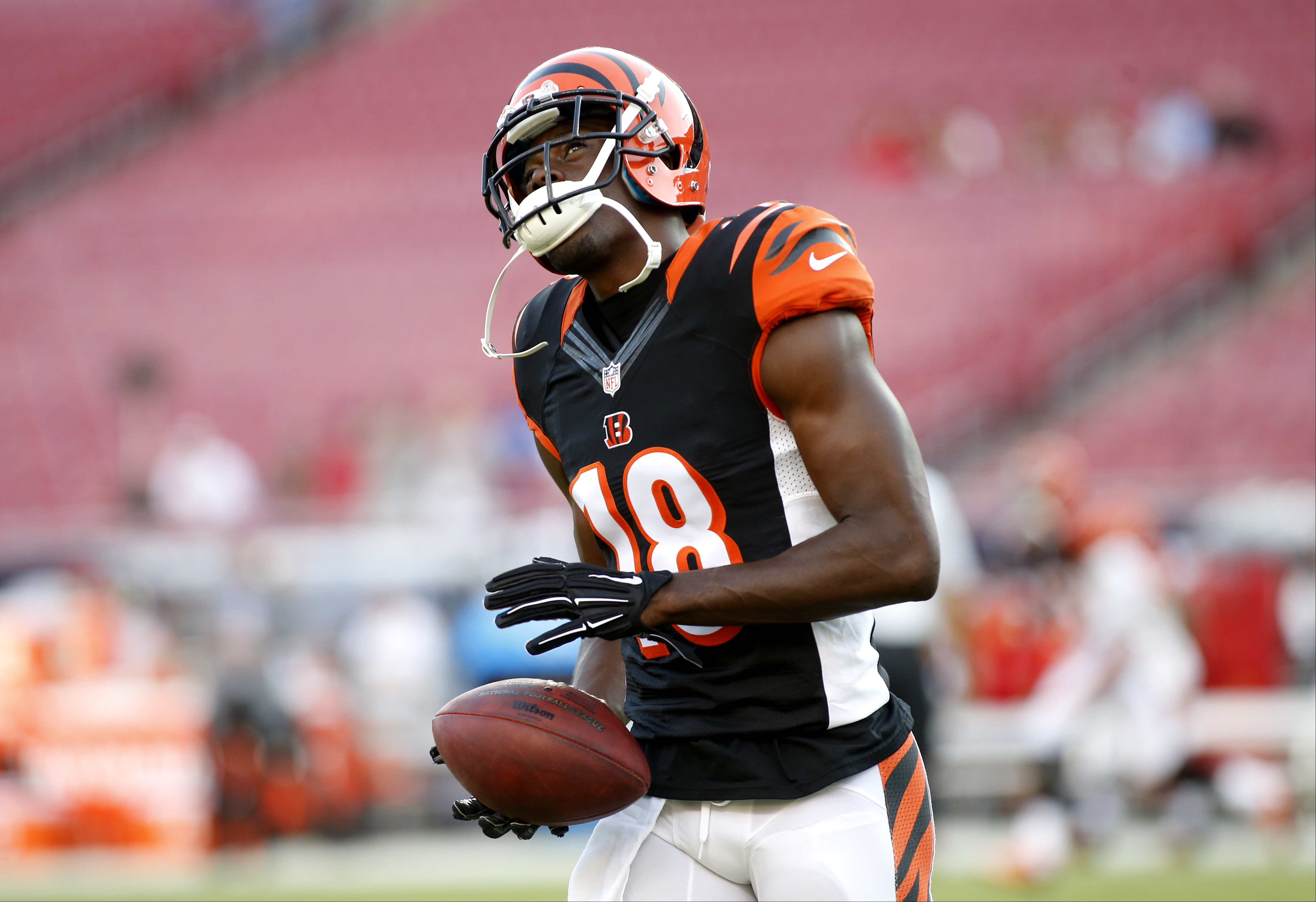 Cincinnati Bengals wide receiver A.J. Green (18) warms up before the start of an NFL preseason football game against the Tampa Bay Buccaneers Monday, Aug. 24, 2015, in Tampa, Fla. (AP Photo/Brian Blanco)