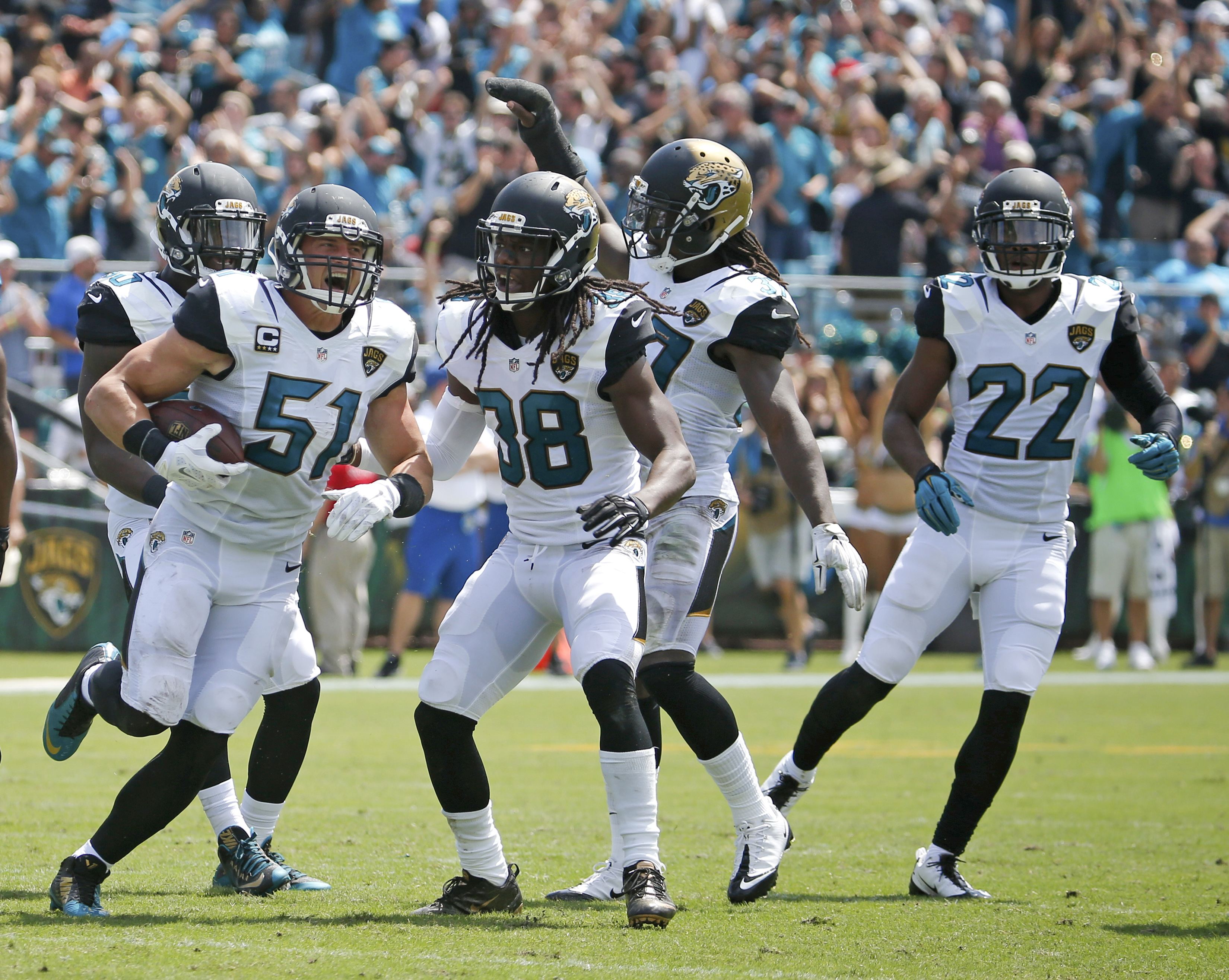 Jacksonville Jaguars middle linebacker Paul Posluszny (51) celebrates an interception against the Carolina Panthers with teammates, including Sergio Brown (38) and cornerback Aaron Colvin (22), during the first half of an NFL football game in Jacksonville
