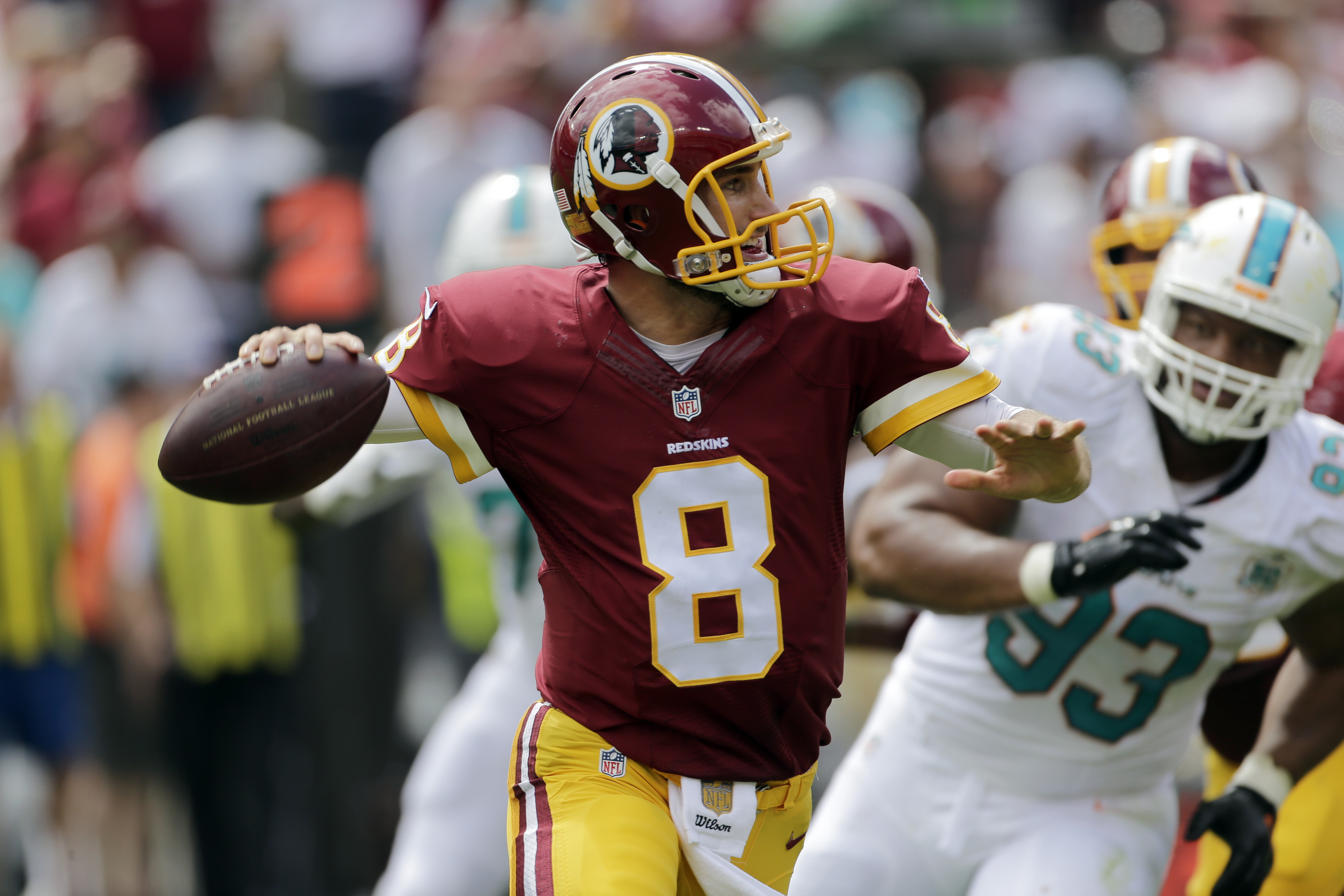 Washington Redskins quarterback Kirk Cousins (8) looks to pass as he is pursued by Miami Dolphins defensive tackle Ndamukong Suh (93) during the first half of an NFL football game Sunday, Sept. 13, 2015, in Landover, Md. (AP Photo/Mark Tenally)