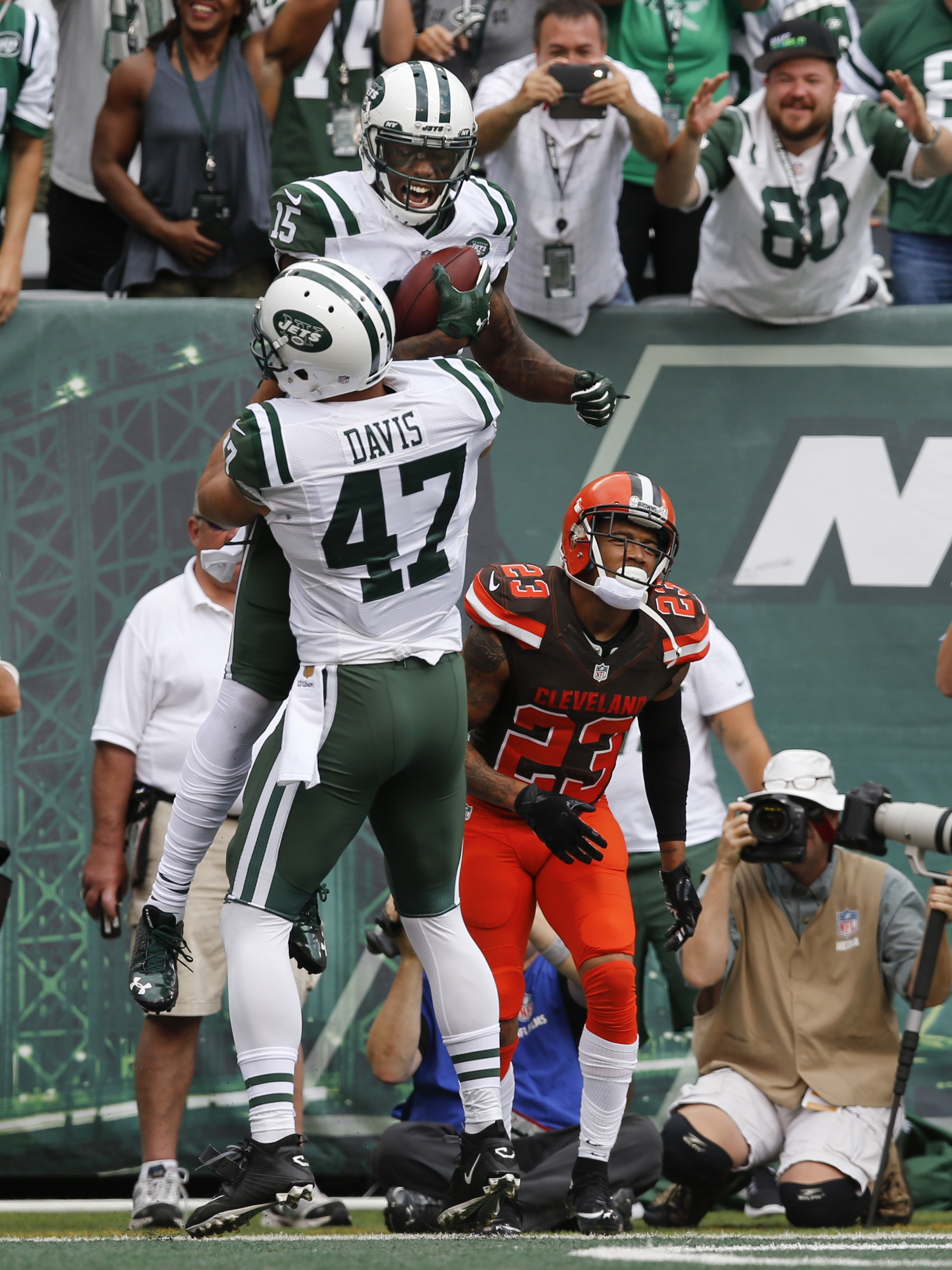 New York Jets wide receiver Brandon Marshall (15) celebrates with teammate Kellen Davis (47) after catching a pass for a touchdown during the second half of an NFL football game against the Cleveland Browns Sunday, Sept. 13, 2015 in East Rutherford, N.J.