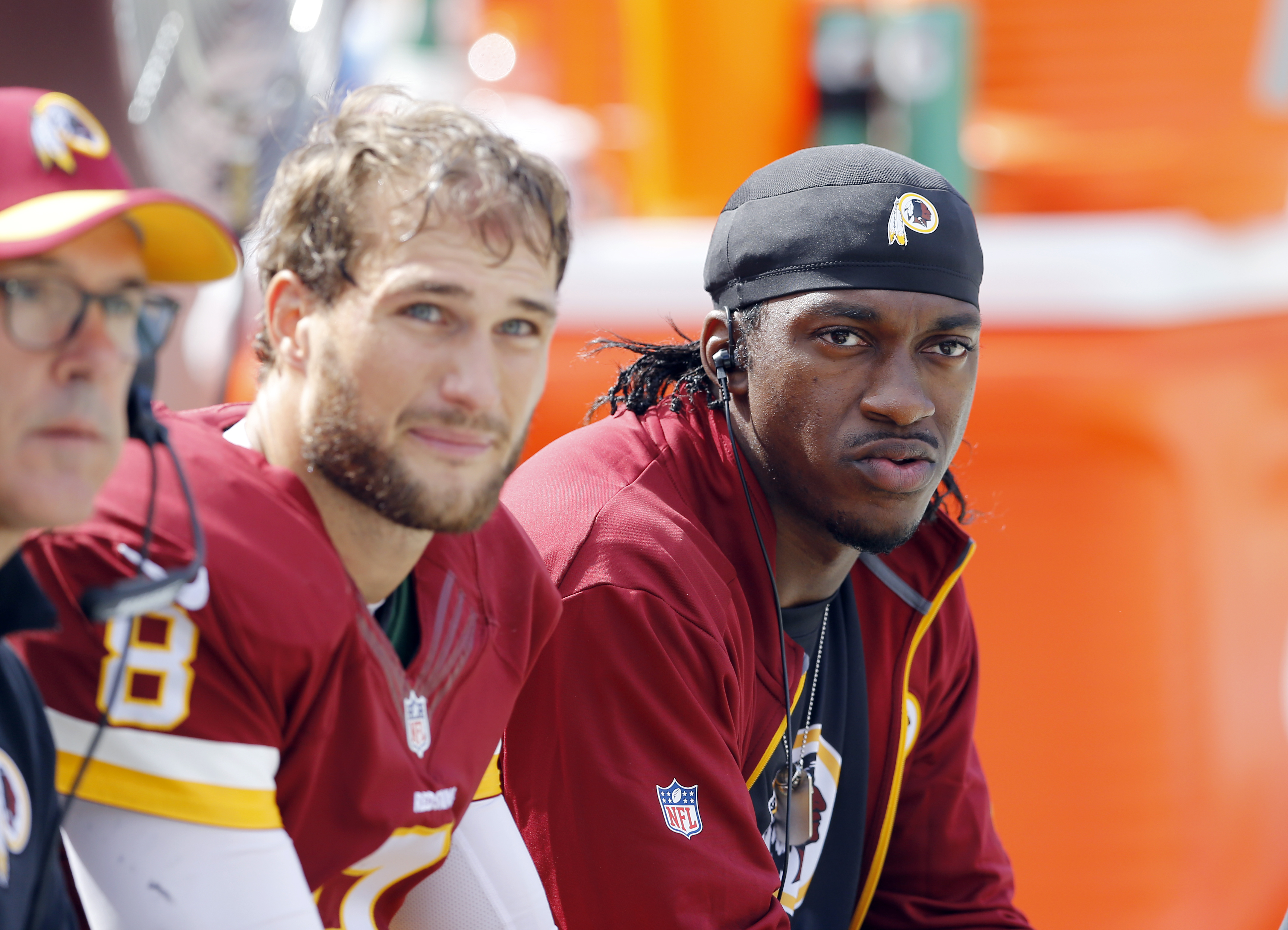 Washington Redskins quarterback Kirk Cousins (8) and quarterback Robert Griffin III, right, sit on the bench during the second half of an NFL football game against the Miami Dolphins, Sunday, Sept. 13, 2015, in Landover, Md. (AP Photo/Patrick Semansky)