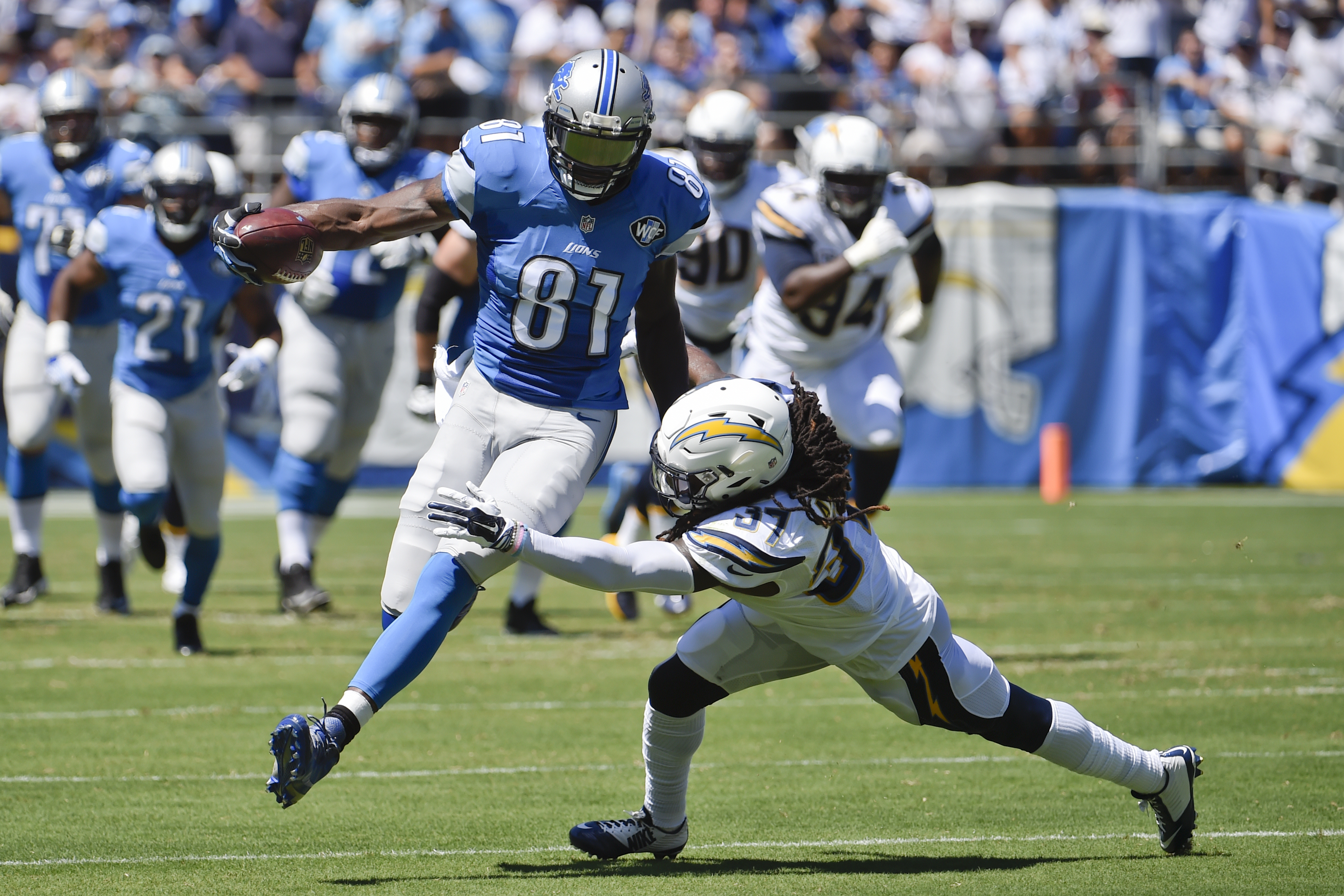 Detroit Lions wide receiver Calvin Johnson (81) runs upfield as San Diego Chargers defensive back Jahleel Addae defends during the first half of an NFL football game Sunday, Sept. 13, 2015, in San Diego. (AP Photo/Denis Poroy)