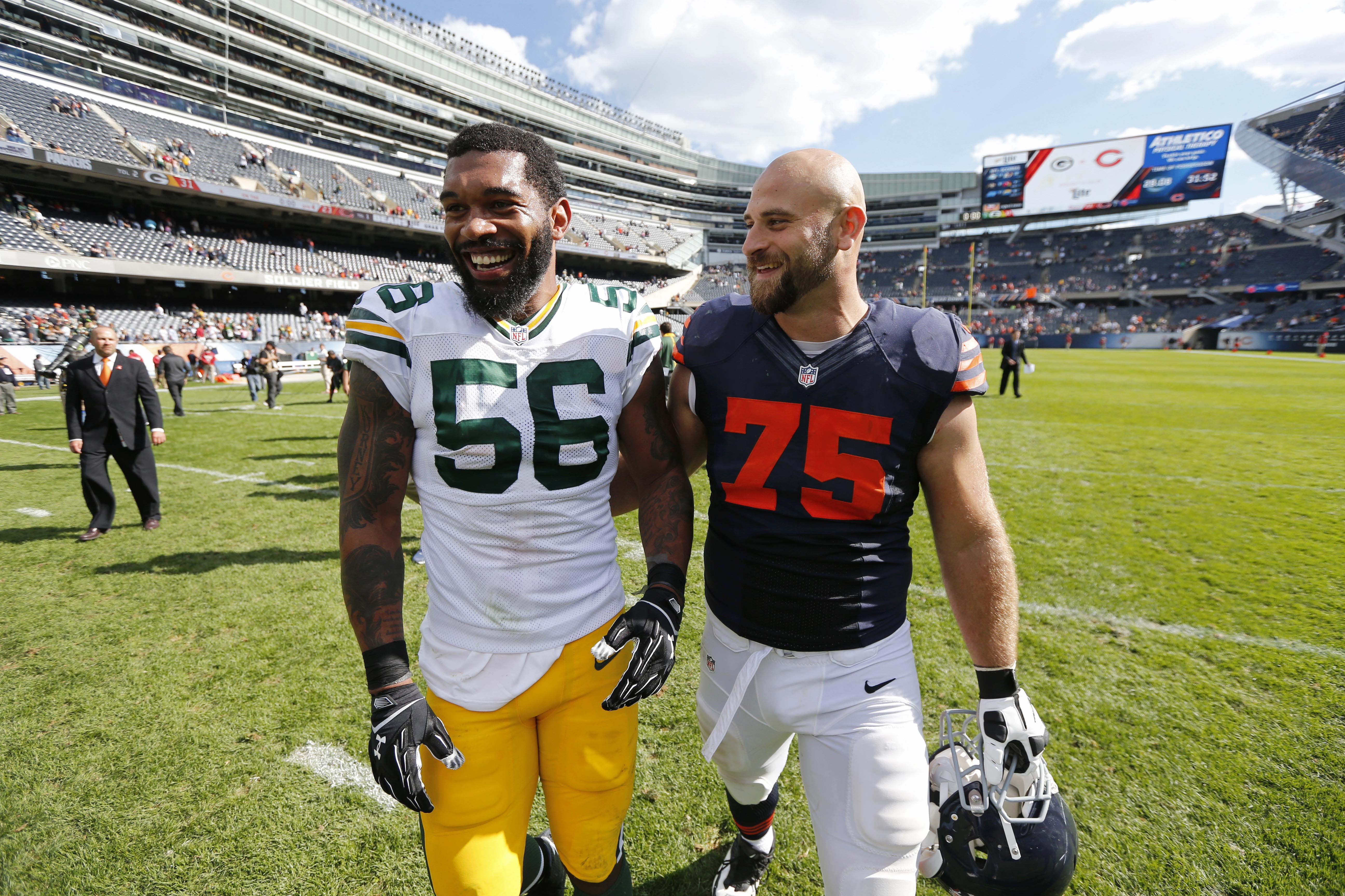 Green Bay Packers outside linebacker Julius Peppers (56) and Chicago Bears guard Kyle Long (75) share laughs after their NFL football game, Sunday, Sept. 13, 2015, in Chicago. The Packers won 31-23. (AP Photo/Charles Rex Arbogast)
