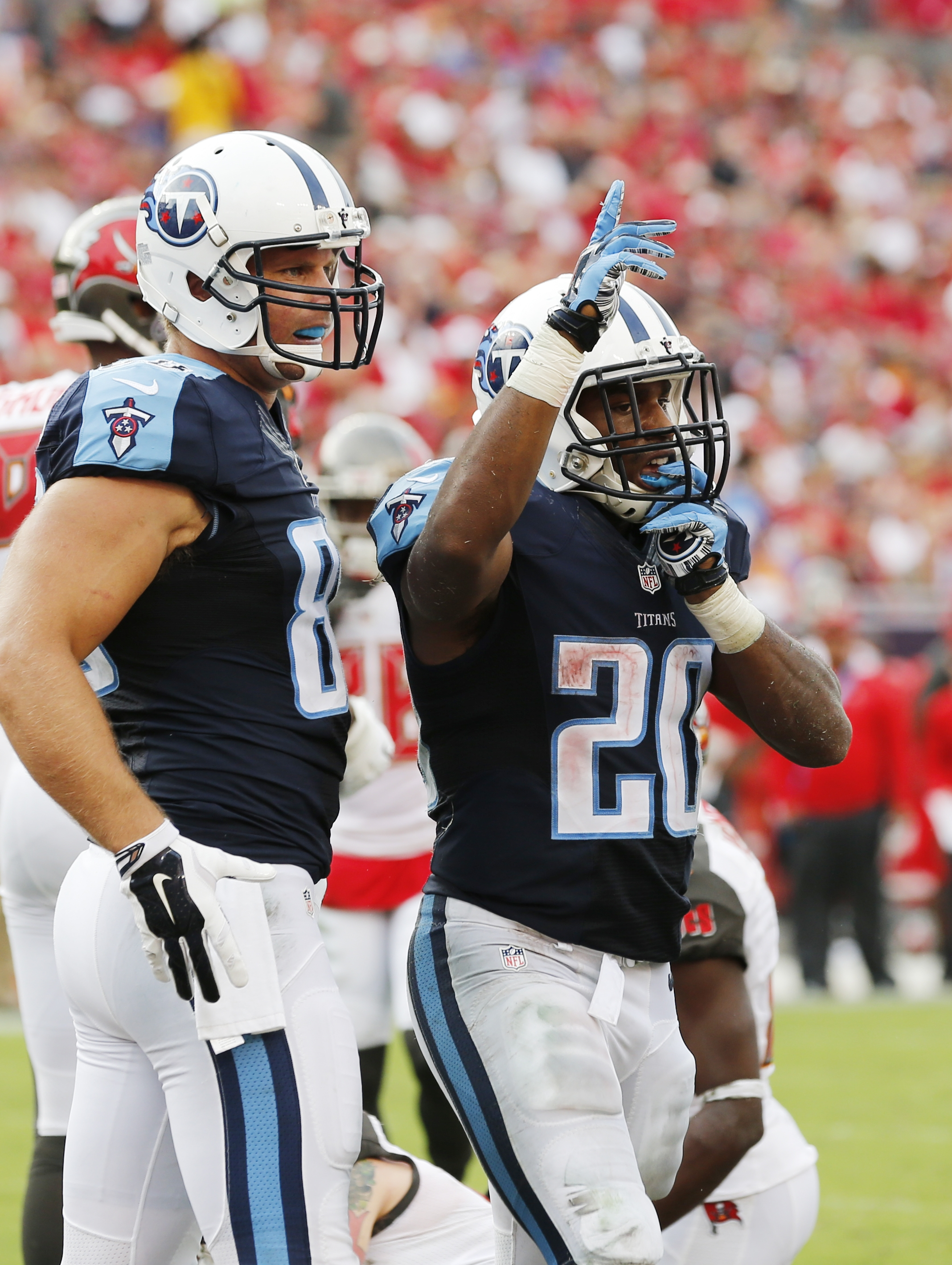 Tennessee Titans running back Bishop Sankey (20) celebrates a touchdown during the second half of an NFL football game against the Tampa Bay Buccaneers, Sunday, Sept. 13, 2015, in Tampa, Fla. (AP Photo/Scott Audette)