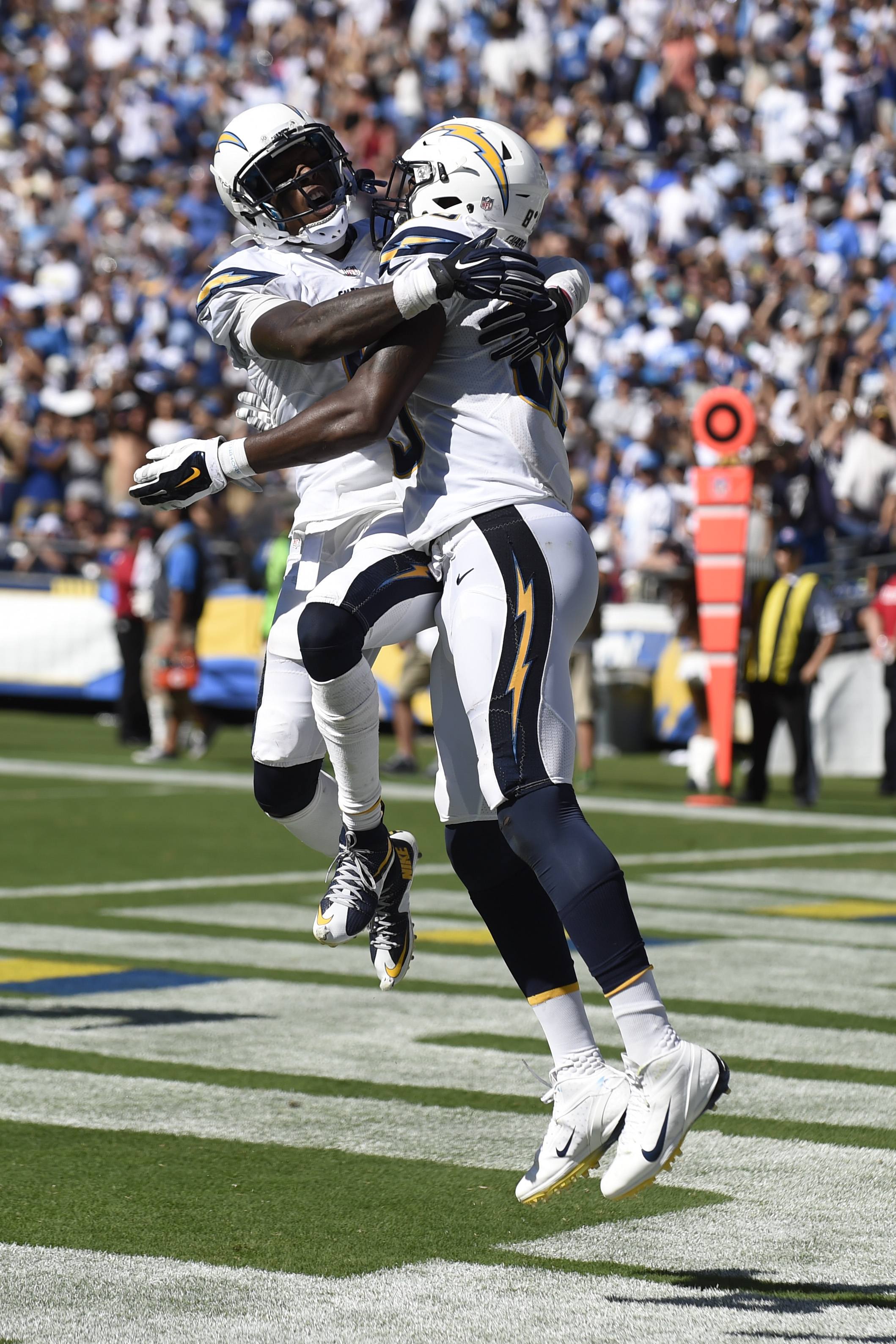 San Diego Chargers wide receiver Steve Johnson, left, celebrates with tight end Ladarius Green after Green scored a touchdown against the Detroit Lions during the second half of an NFL football game Sunday, Sept. 13, 2015, in San Diego. (AP Photo/Denis Po