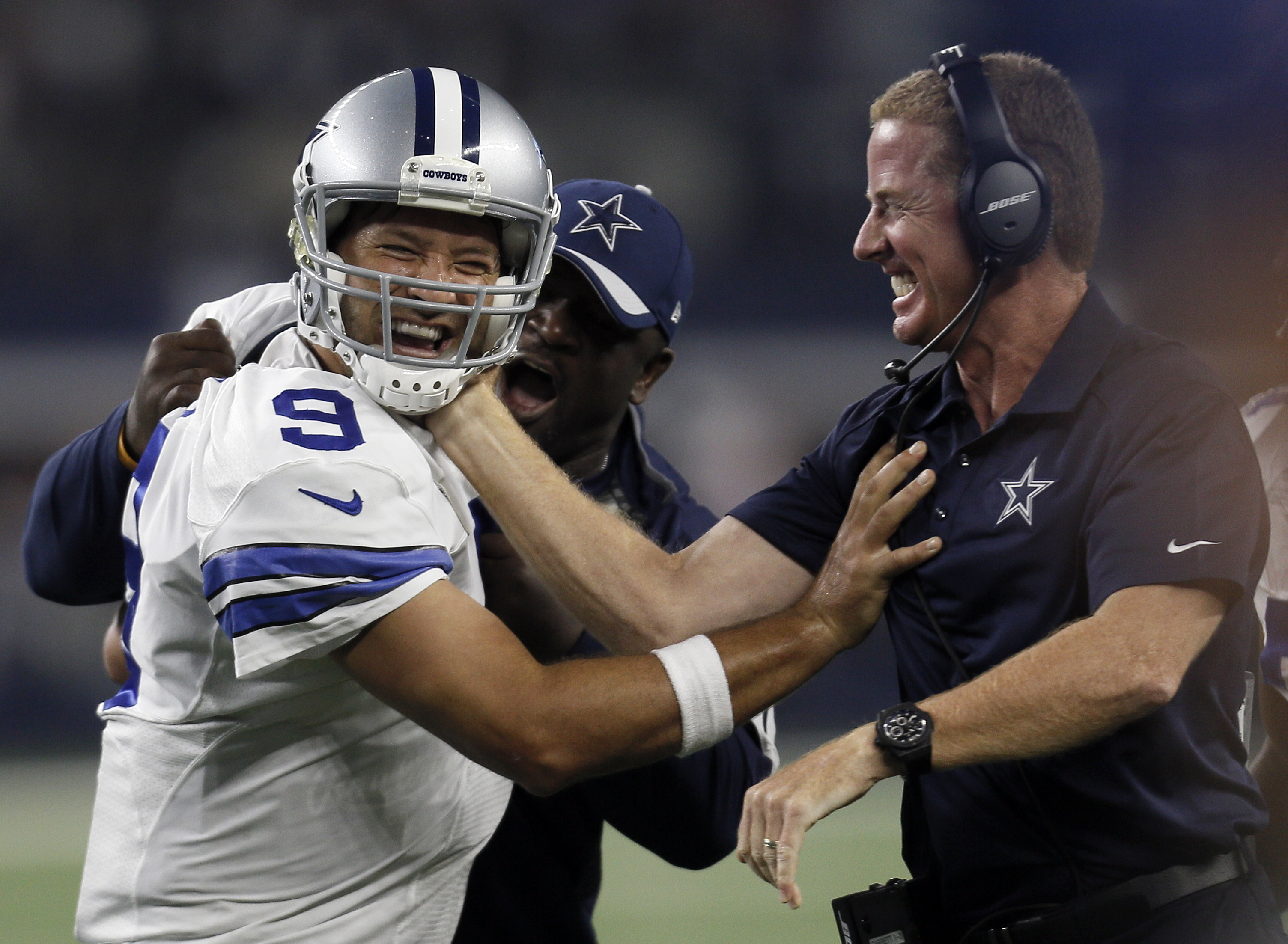 Dallas Cowboys quarterback Tony Romo and head coach Jason Garrett celebrate a last minute touchdown pass to tight end Jason Witten (82) to win against the New York Giants during the second half of an NFL football game Sunday, Sept. 13, 2015, in Arlington,