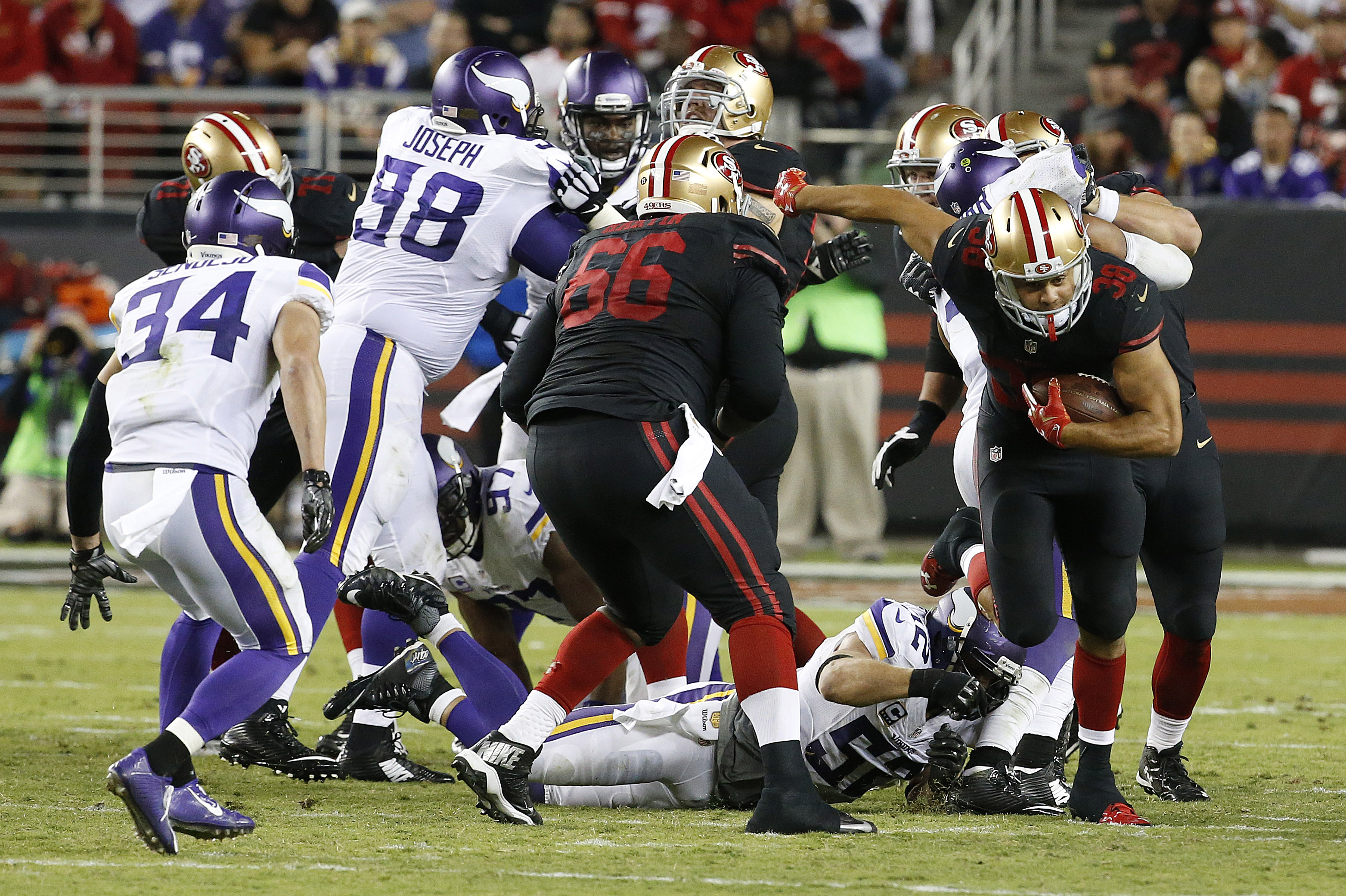 San Francisco 49ers running back Jarryd Hayne, right, runs against the Minnesota Vikings during the second half of an NFL football game in Santa Clara, Calif., Monday, Sept. 14, 2015. (AP Photo/Tony Avelar)
