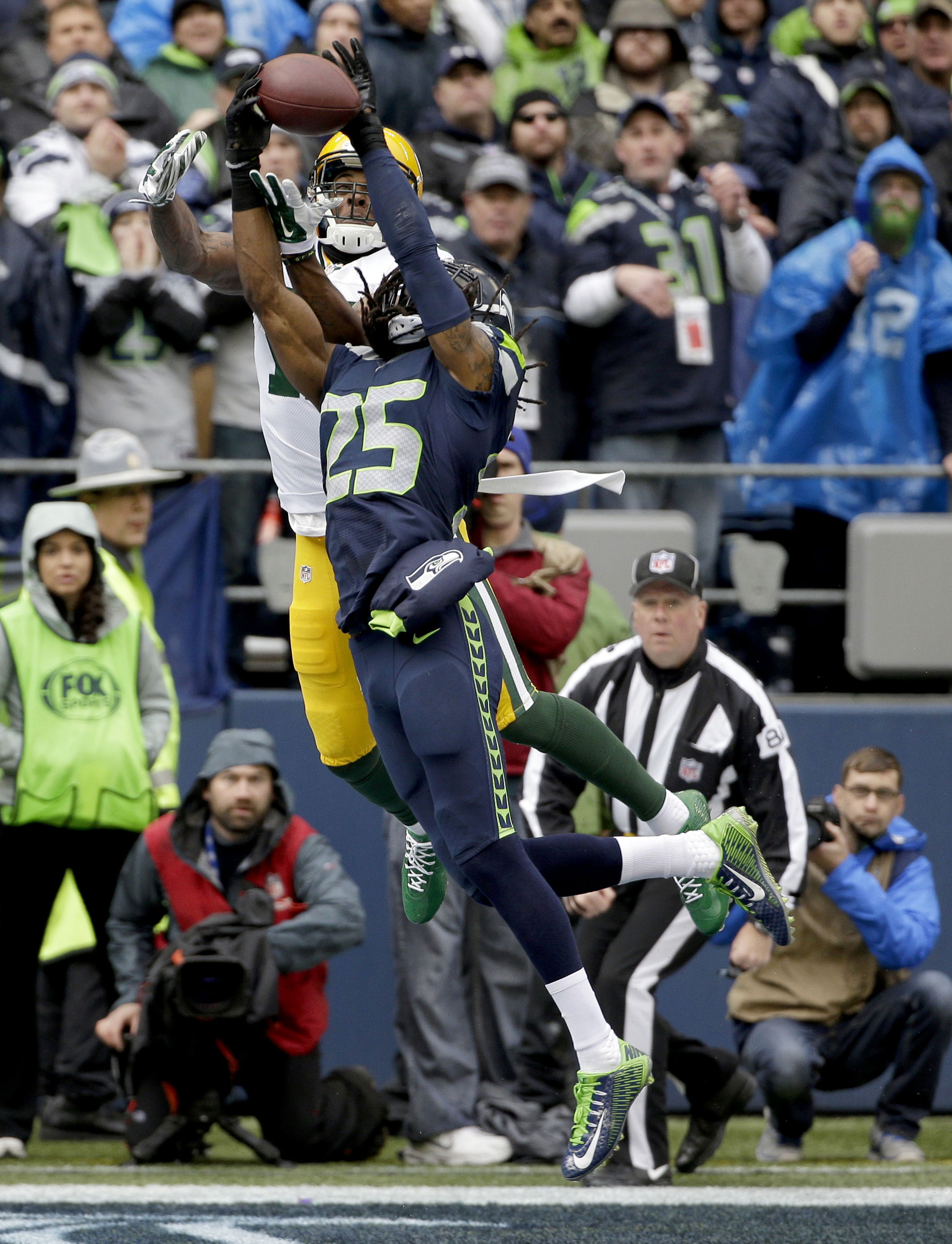 FILE - In this Jan. 18, 2015, file photo, Seattle Seahawks cornerback Richard Sherman (25) intercepts a pass intended for Green Bay Packers wide receiver Davante Adams (17) during the first half of the NFL football NFC Championship game in Seattle. The Pa