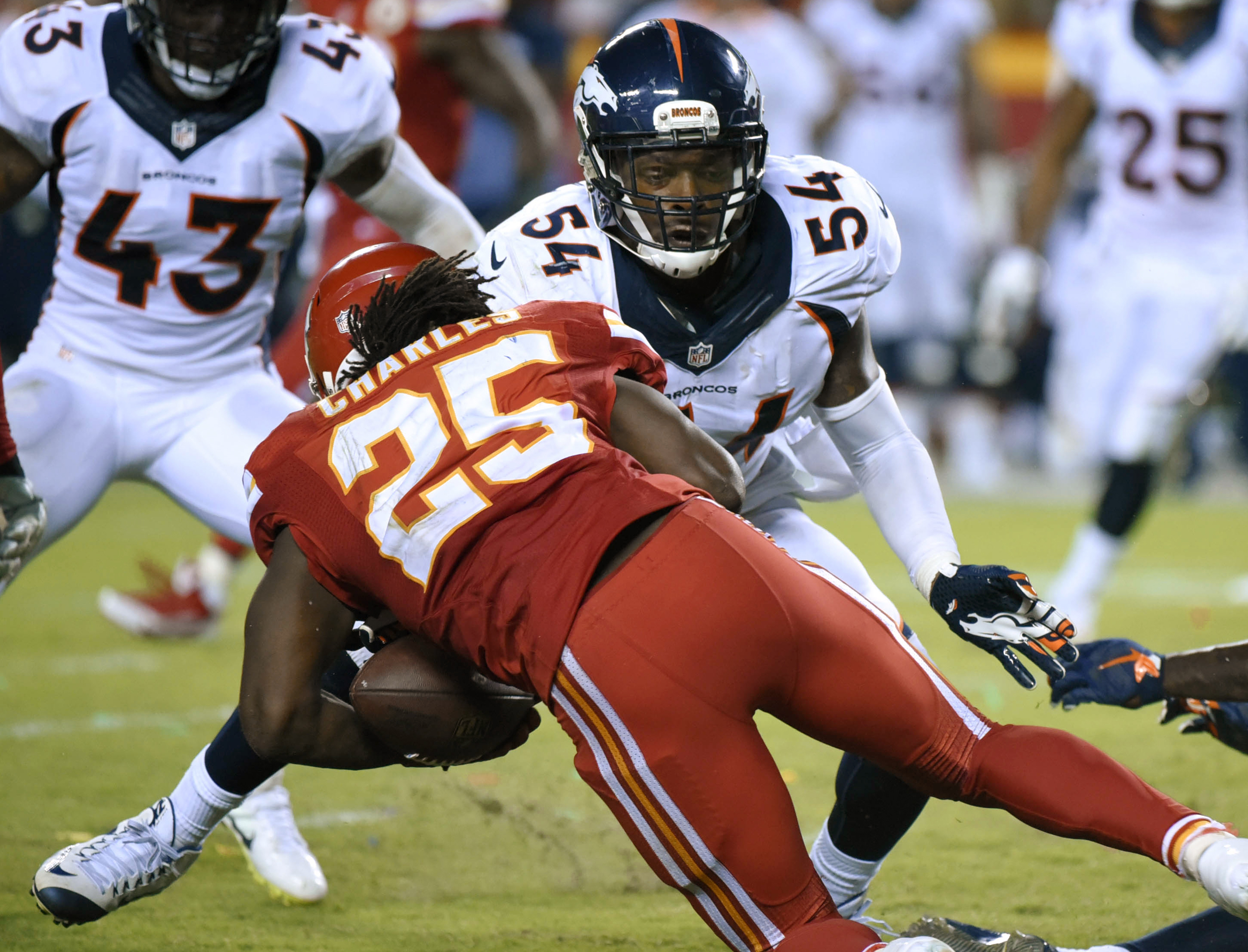 Kansas City Chiefs running back Jamaal Charles (25) is tackled by Denver Broncos linebacker Brandon Marshall (54) and fumbles the ball for a turnover during the second half of an NFL football game in Kansas City, Mo., Thursday, Sept. 17, 2015. The ball wa