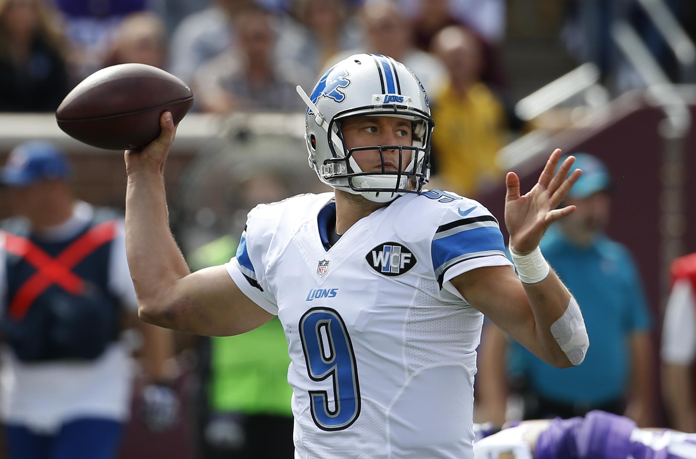 Detroit Lions quarterback Matthew Stafford (9) throws against the Minnesota Vikings in the first half of an NFL football game in Minneapolis, Sunday, Sept. 20, 2015. (AP Photo/Ann Heisenfelt)