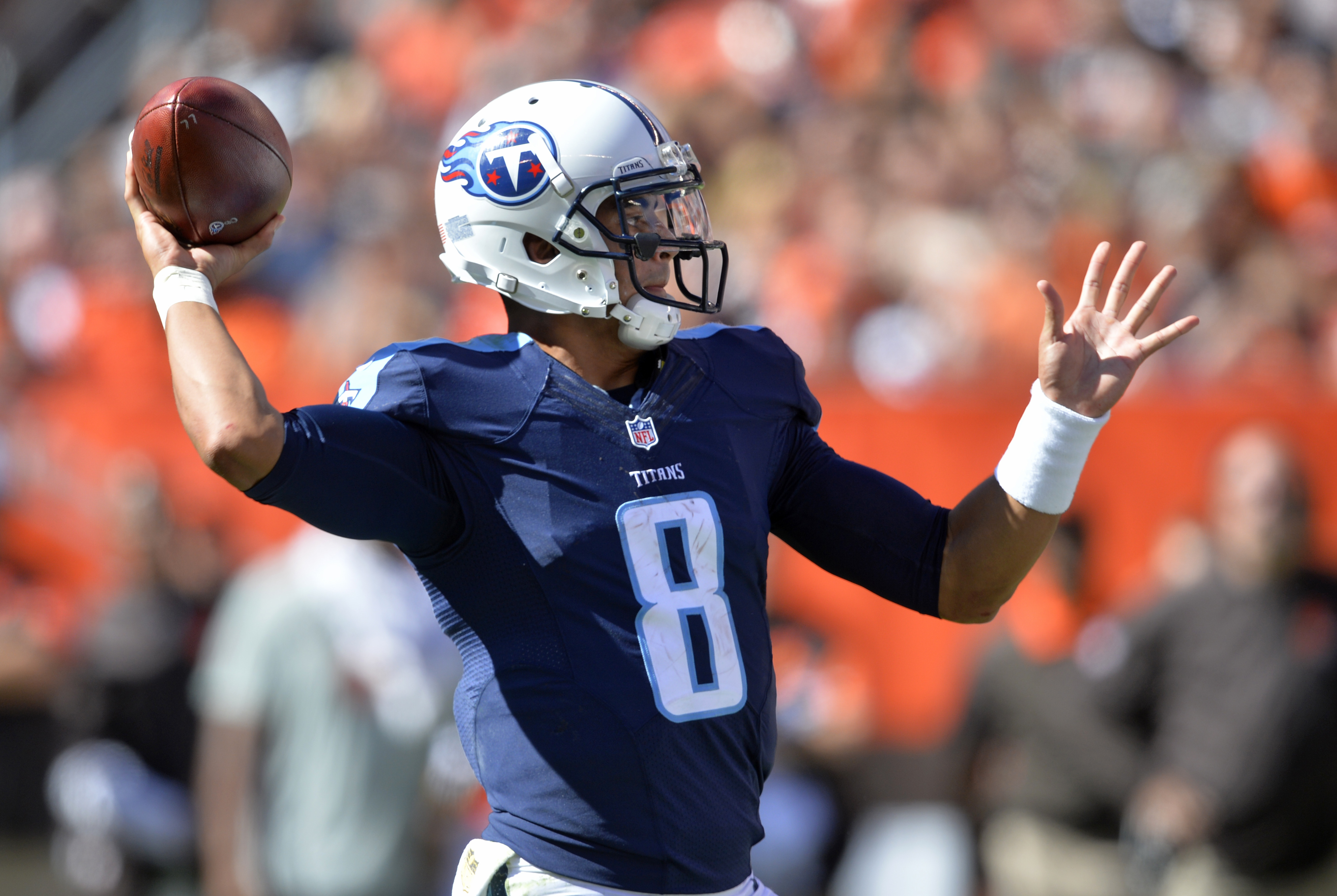 Tennessee Titans quarterback Marcus Mariota (8) throws a 19-yard touchdown pass to tight end Anthony Fasano during the second half of an NFL football game Sunday, Sept. 20, 2015, in Cleveland. (AP Photo/David Richard)