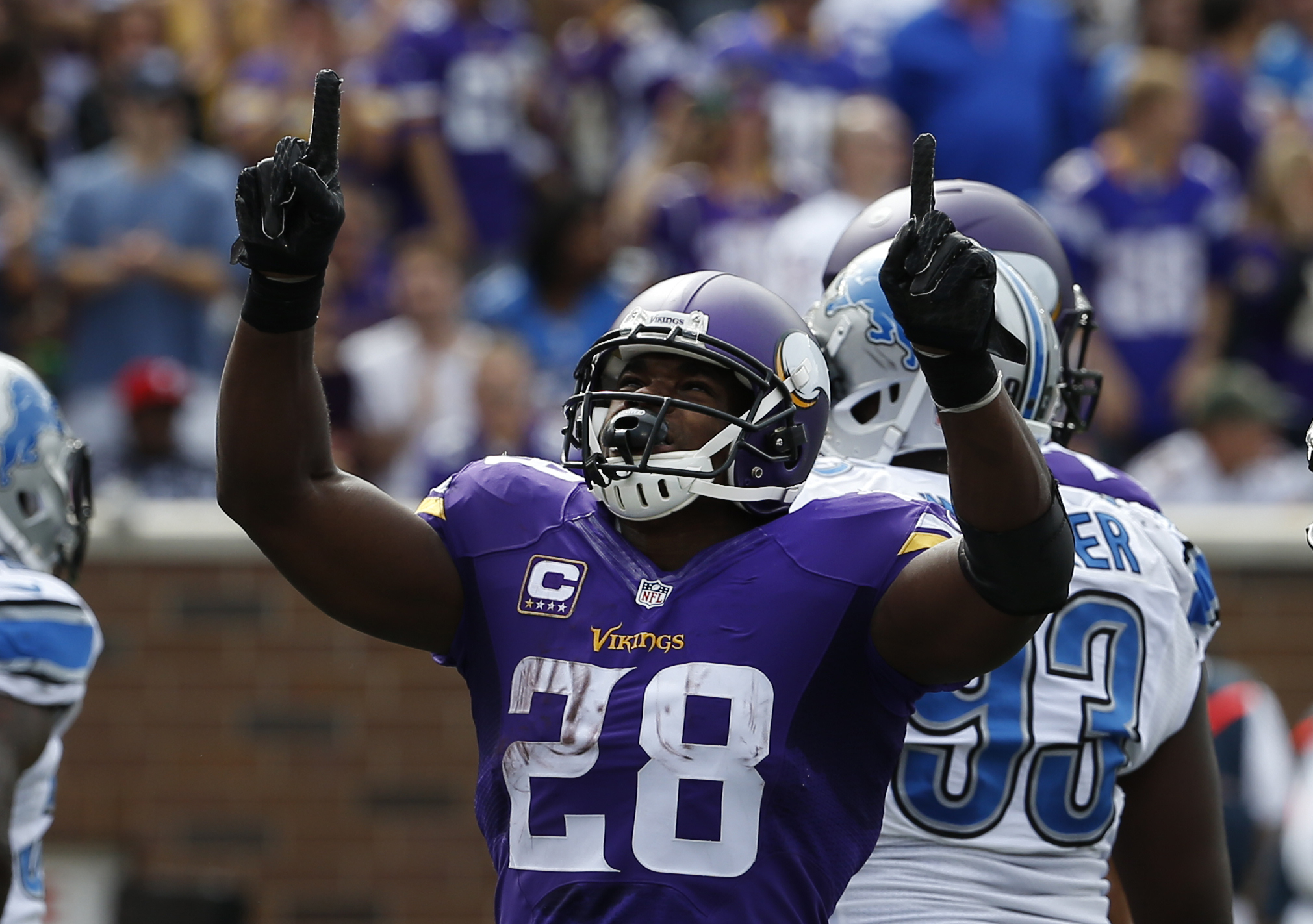 Minnesota Vikings running back Adrian Peterson (28) celebrates a touchdown, that was overturned after review, against the Detroit Lions in the first half of an NFL football game in Minneapolis, Sunday, Sept. 20, 2015. (AP Photo/Ann Heisenfelt)