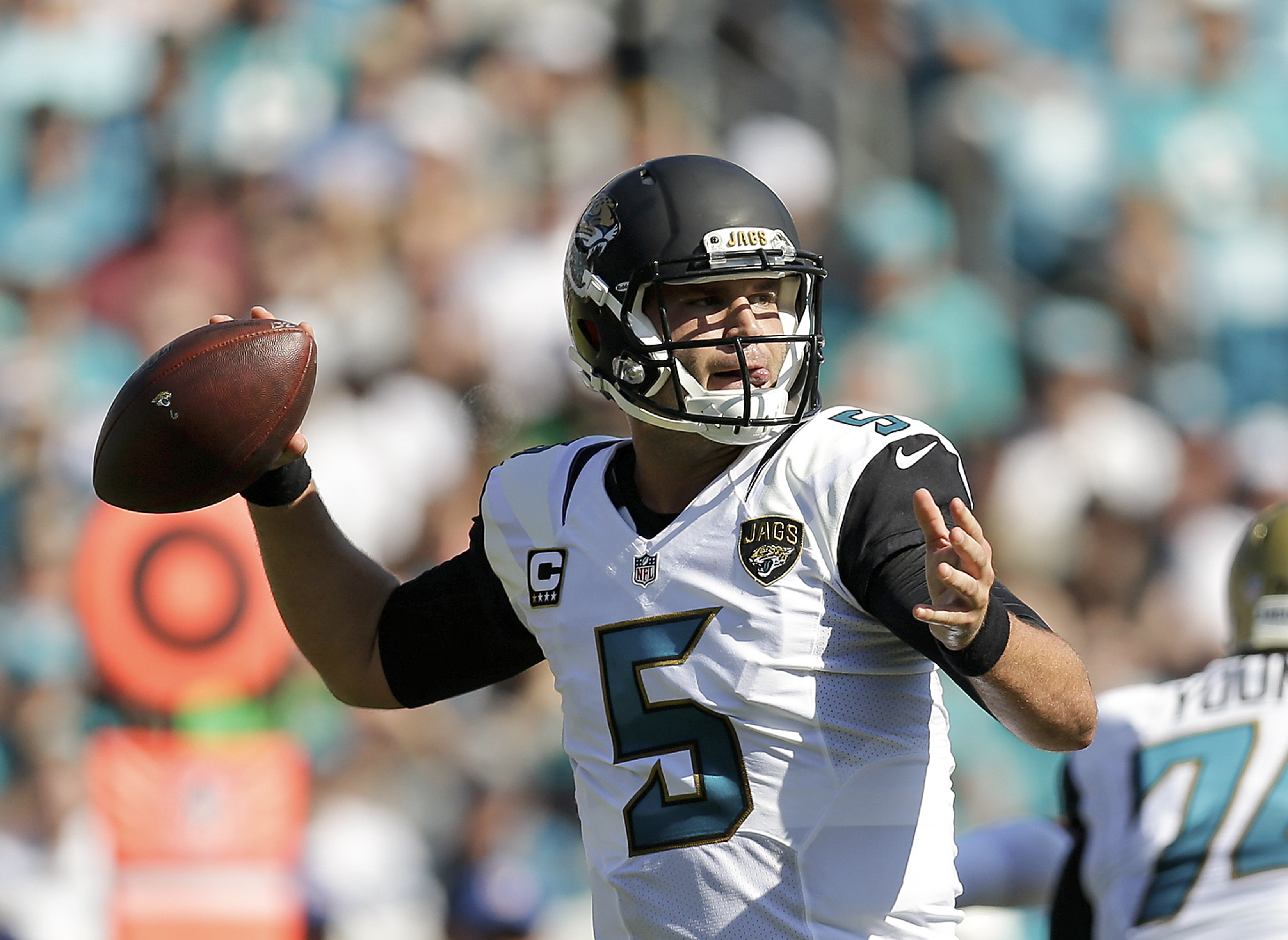 Jacksonville Jaguars quarterback Blake Bortles (5) throws a pass against the Miami Dolphins during the first half of an NFL football game in Jacksonville, Fla., Sunday, Sept. 20, 2015. (AP Photo/Mike Stewart)
