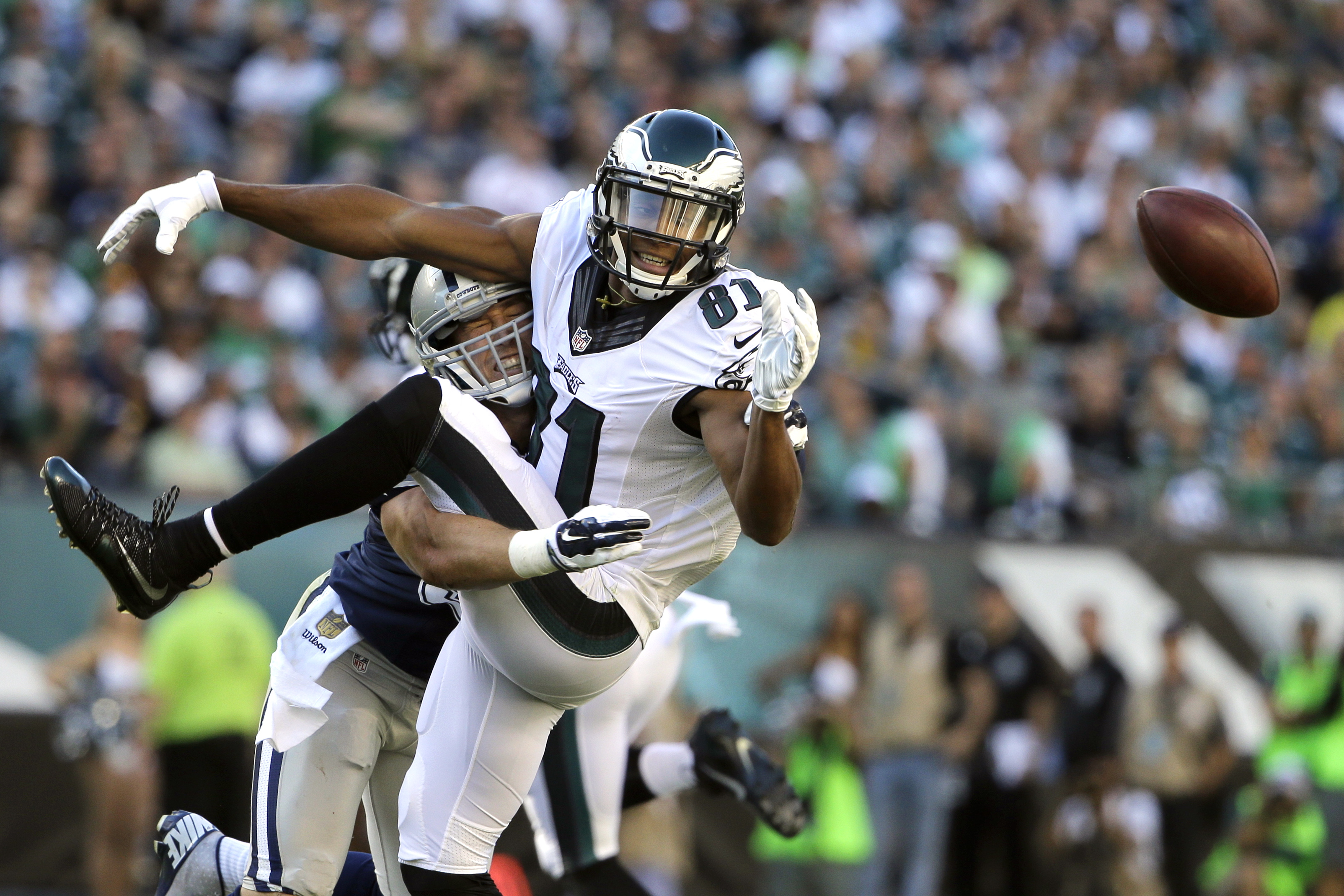 Philadelphia Eagles' Jordan Matthews, right, cannot catch a pass from Sam Bradford as he is hit by Dallas Cowboys' Sean Lee during the first half of an NFL football game, Sunday, Sept. 20, 2015, in Philadelphia. (AP Photo/Matt Rourke)